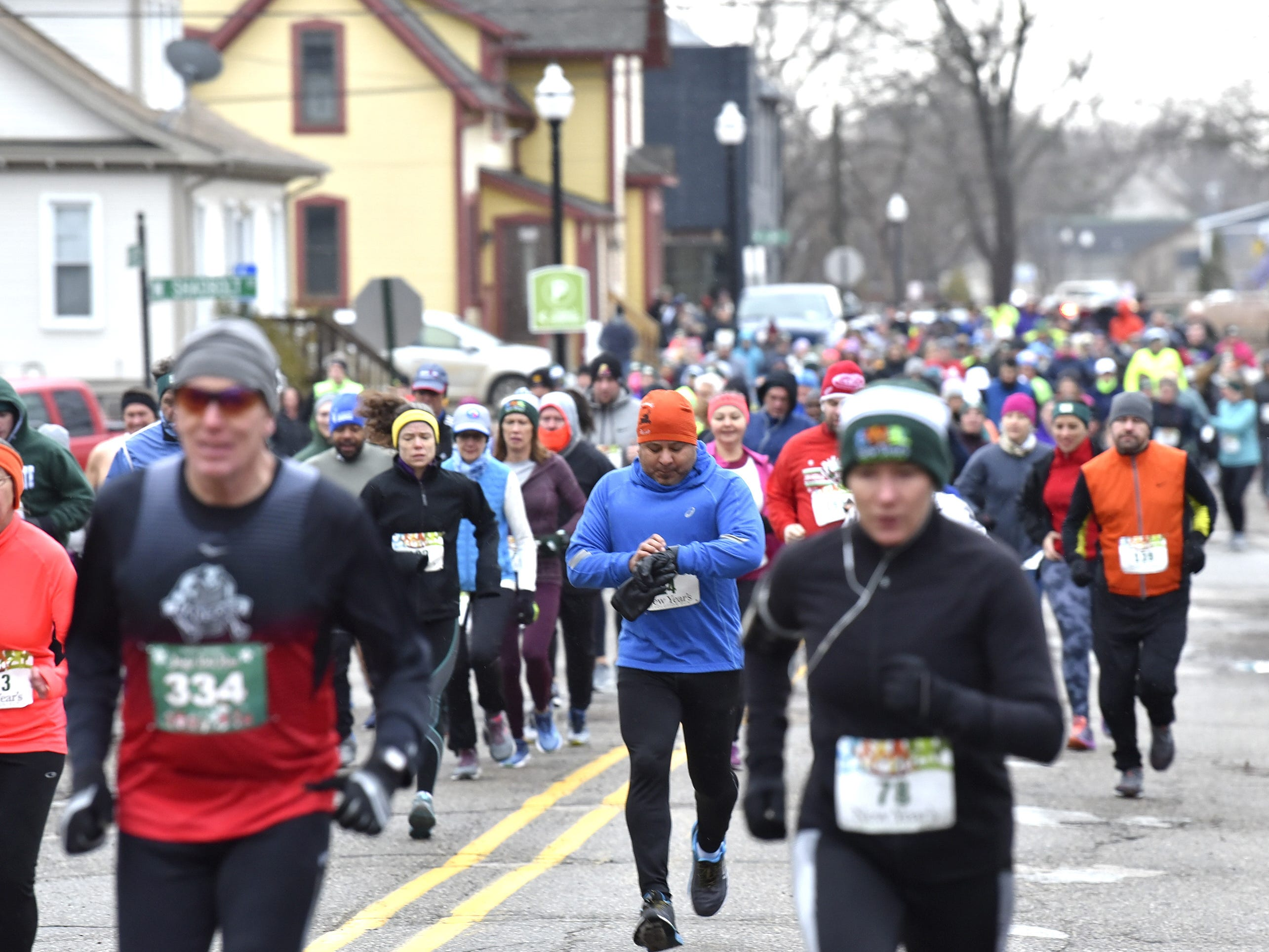 Art Ibarra (24), center, starts his watch at the beginning of the run. He finishes in 7th place for males ages 50-59 and 44th overall.