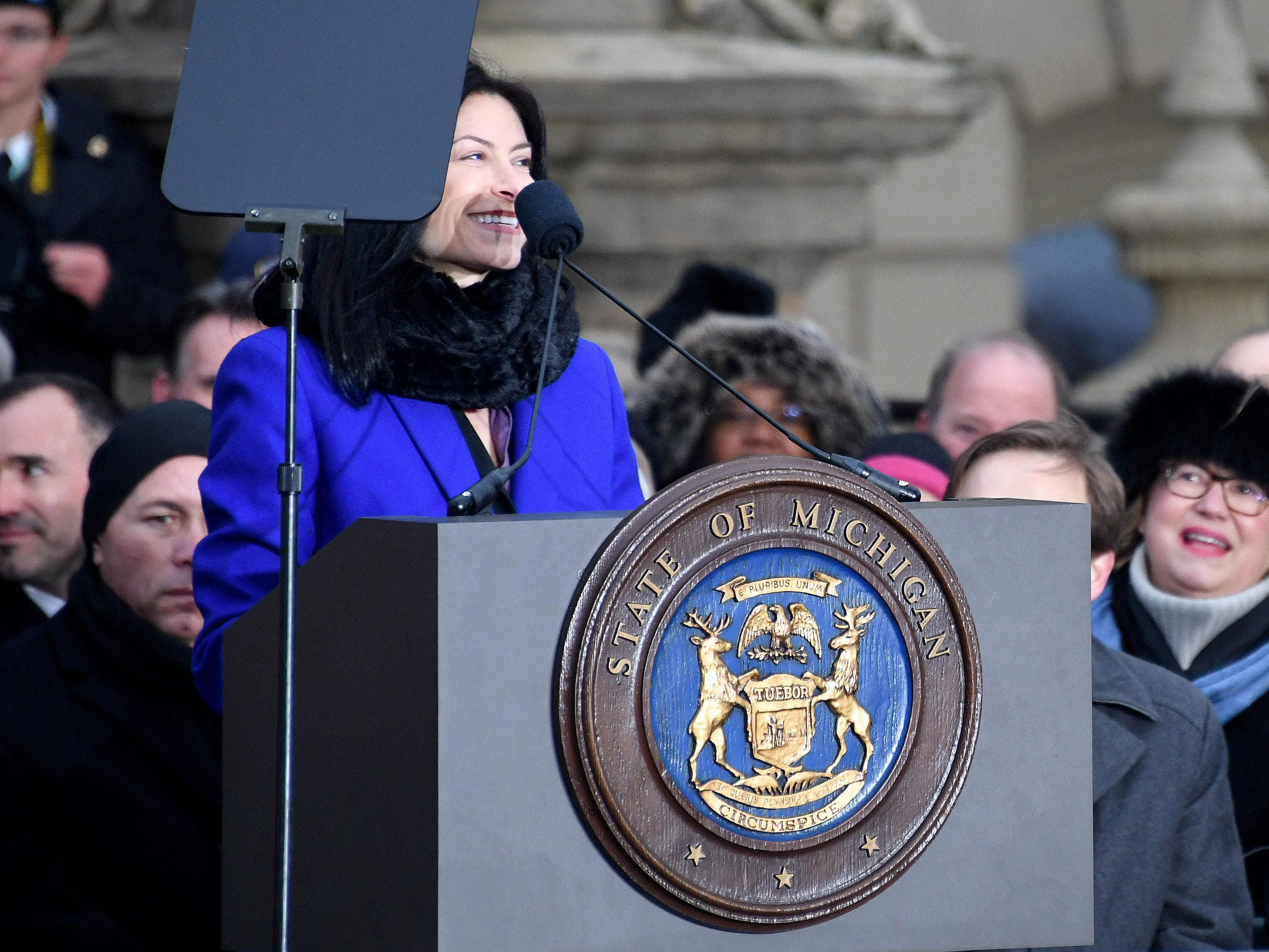Attorney General Dana Nessel grins after taking her oath of office.
