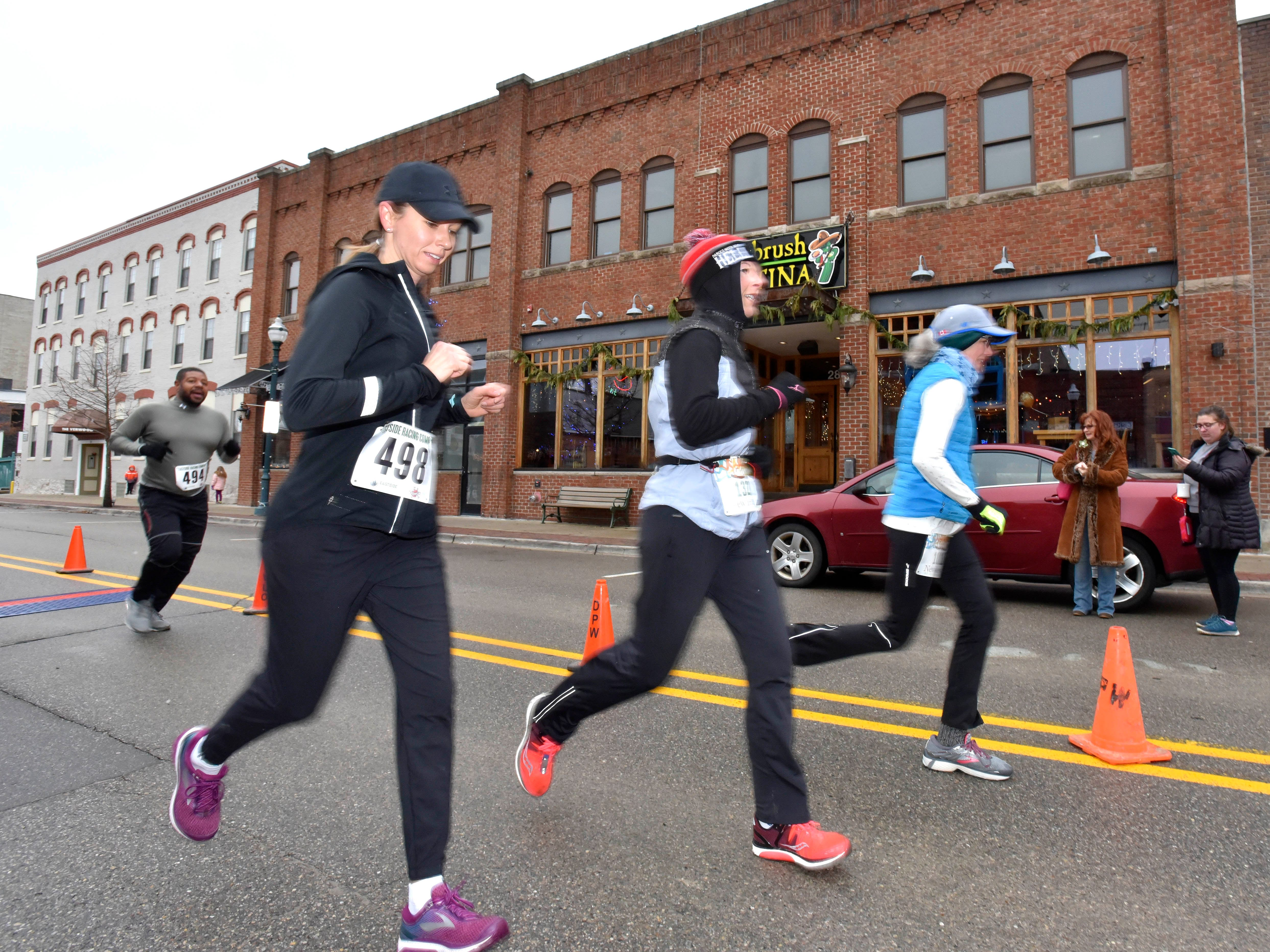 Tracie Kay Hutchinson, left, (498) finishes 12th in females ages 40-49 and 93rd overall as Amber Williamson (132) finishes 11th in females ages 40-49 and 92nd overall while Laura Sawyer (167) finishes 2nd in females ages 60-69 and 83rd overall.
