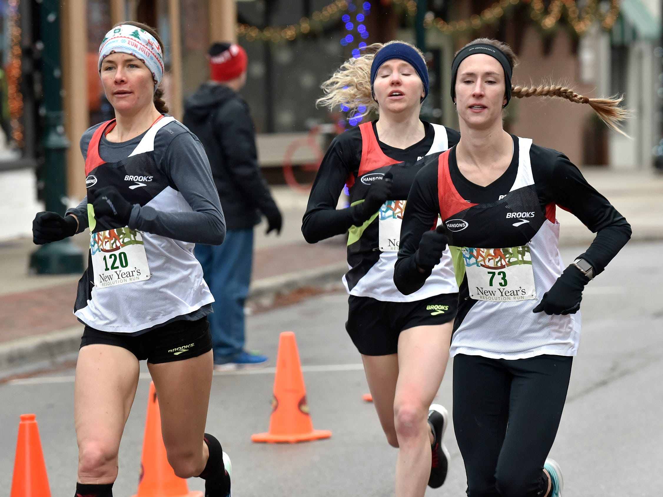 Danna Herrick, left, (120) places first in females ages 30-39 and 9th overall as Chelsea Blaase (71) places first in females ages 20-29 and 7th overall while Anne Marie Blaney (73) places 2nd in females ages 20-29 and 8th overall.