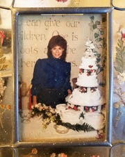 Darla Daily Smith in the early 1980's, with an elaborate wedding cake typical of the time.