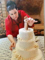 Darla Smith working on a cake at Daily's Annex Bakery in this photo taken earlier this year.
