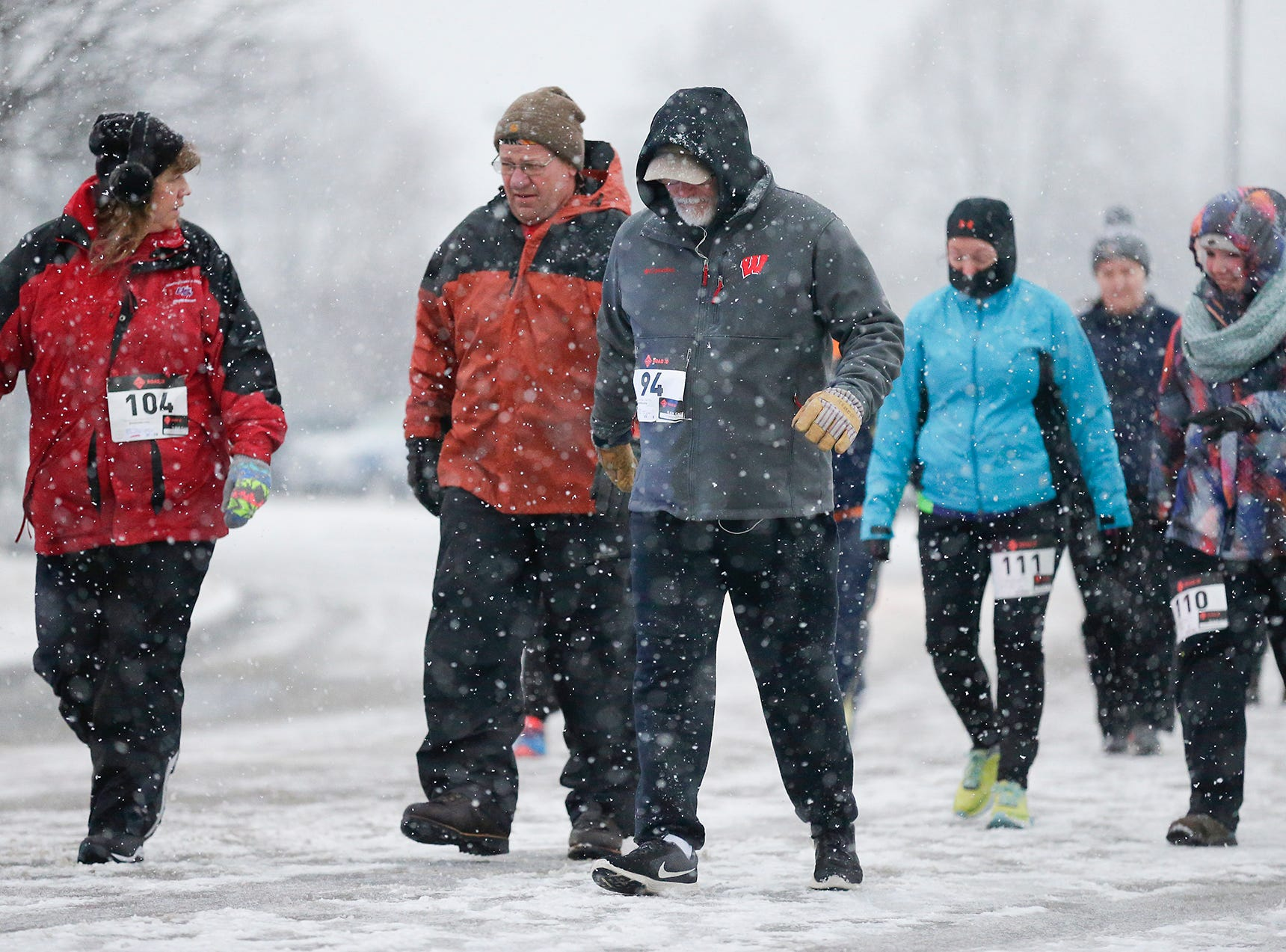 Dozens of runners start the Chilly Chili 5k run/walk Saturday, December 31, 2018 at Marian College in Fond du Lac, Wisconsin. Doug Raflik/USA TODAY NETWORK-Wisconsin