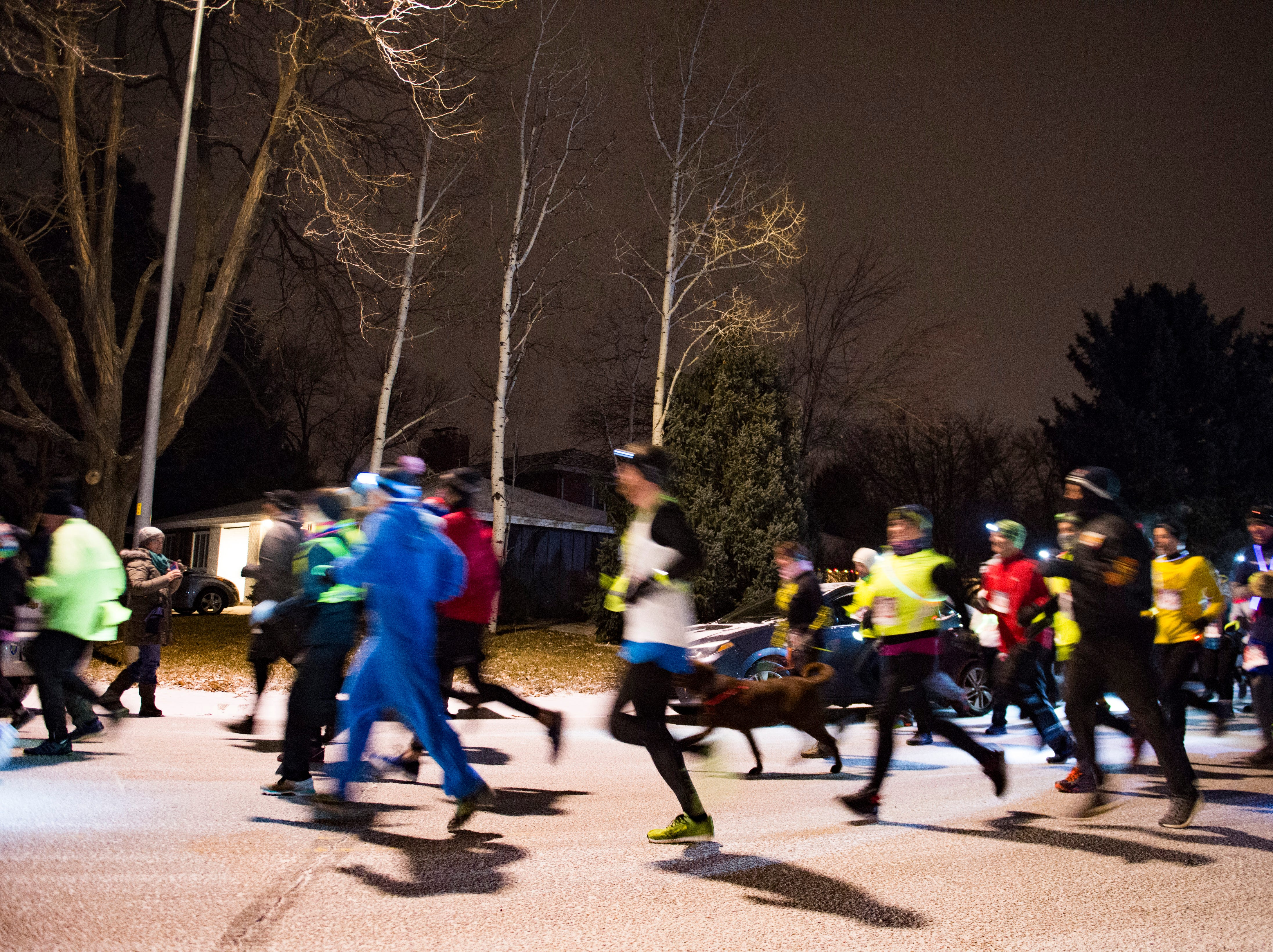 Runners begin the Resolution Run 5K at Our Saviour's Lutheran Church on December 31, 2018. People braved single-digit temperatures to ring in the new year with the run.