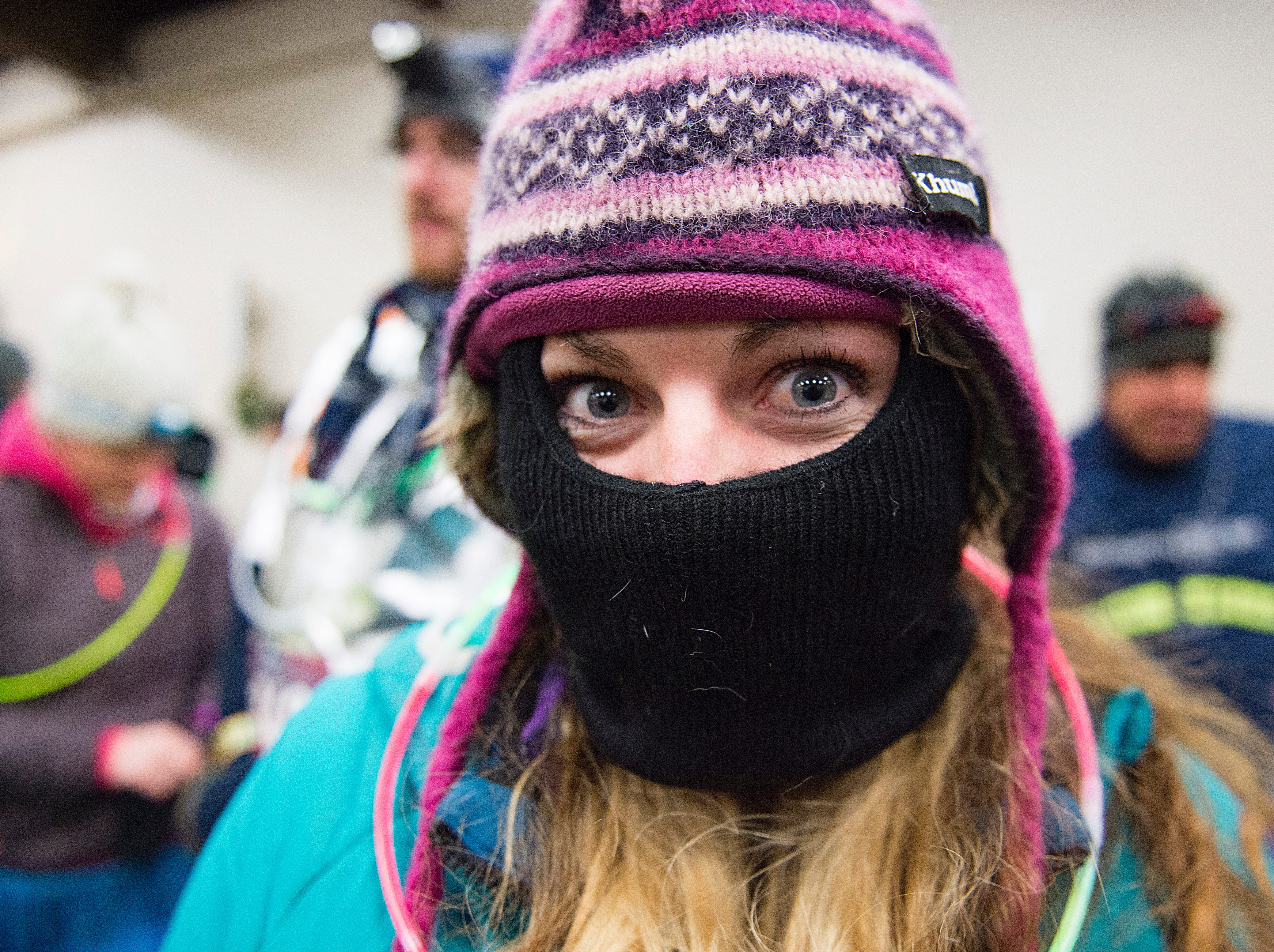 Courtney Blackmon bundles up before the Resolution Run 5K at Our Saviour's Lutheran Church on December 31, 2018. People braved single-digit temperatures to ring in the new year with the run.
