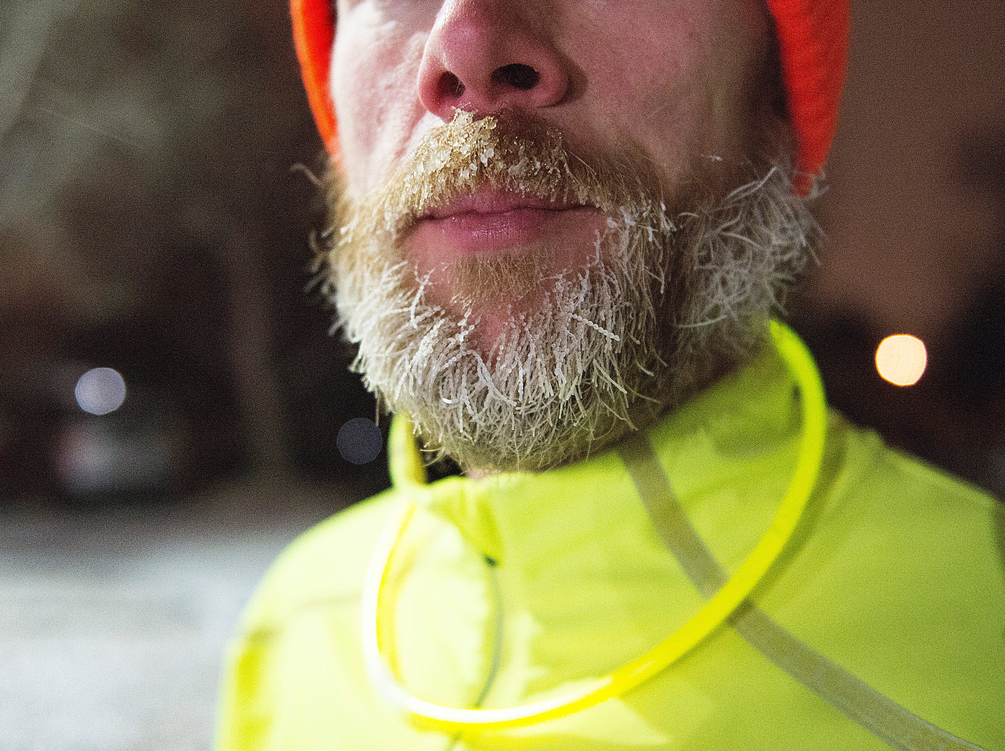 Frost forms on race winner Stephen Pretak's beard at the finish line for the Resolution Run 5K at Our Saviour's Lutheran Church on December 31, 2018. People braved single-digit temperatures to ring in the new year with the run.