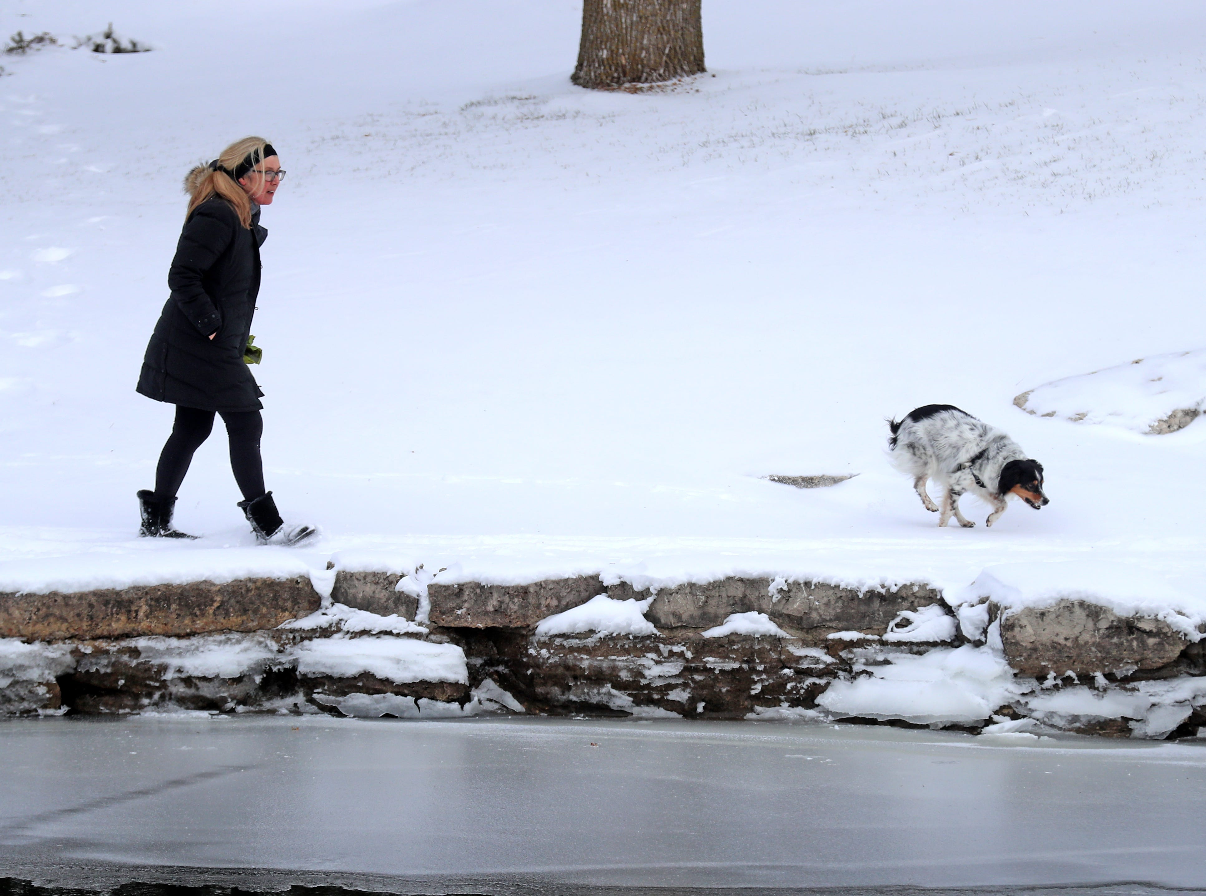 A snowy New Years Day greeted walkers and dogs alike in Voyaguer Park in De Pere, WIs Tuesday, January 1, 2019.
