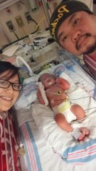 Zayne with his parents, Alee Her and Ryoji Chang.