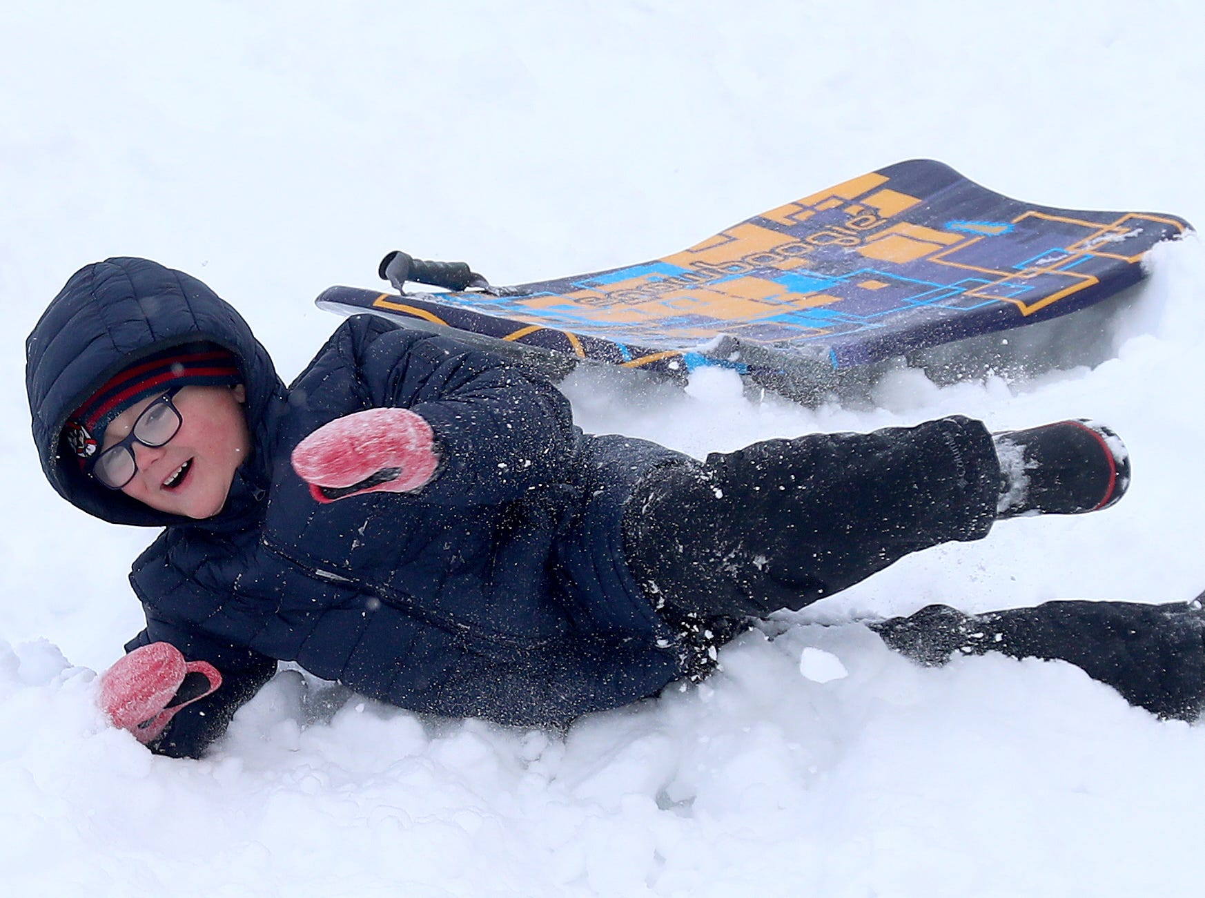 Several inches of snow brought New Years Day fun to several families at the Josten Park sled hill Tuesday, January 1, 2019 in Bellevue, Wis