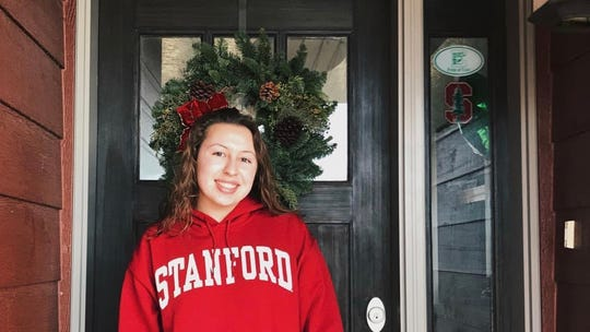Alyssa LaTray posing with her Stanford gear after making her decision to attend the university