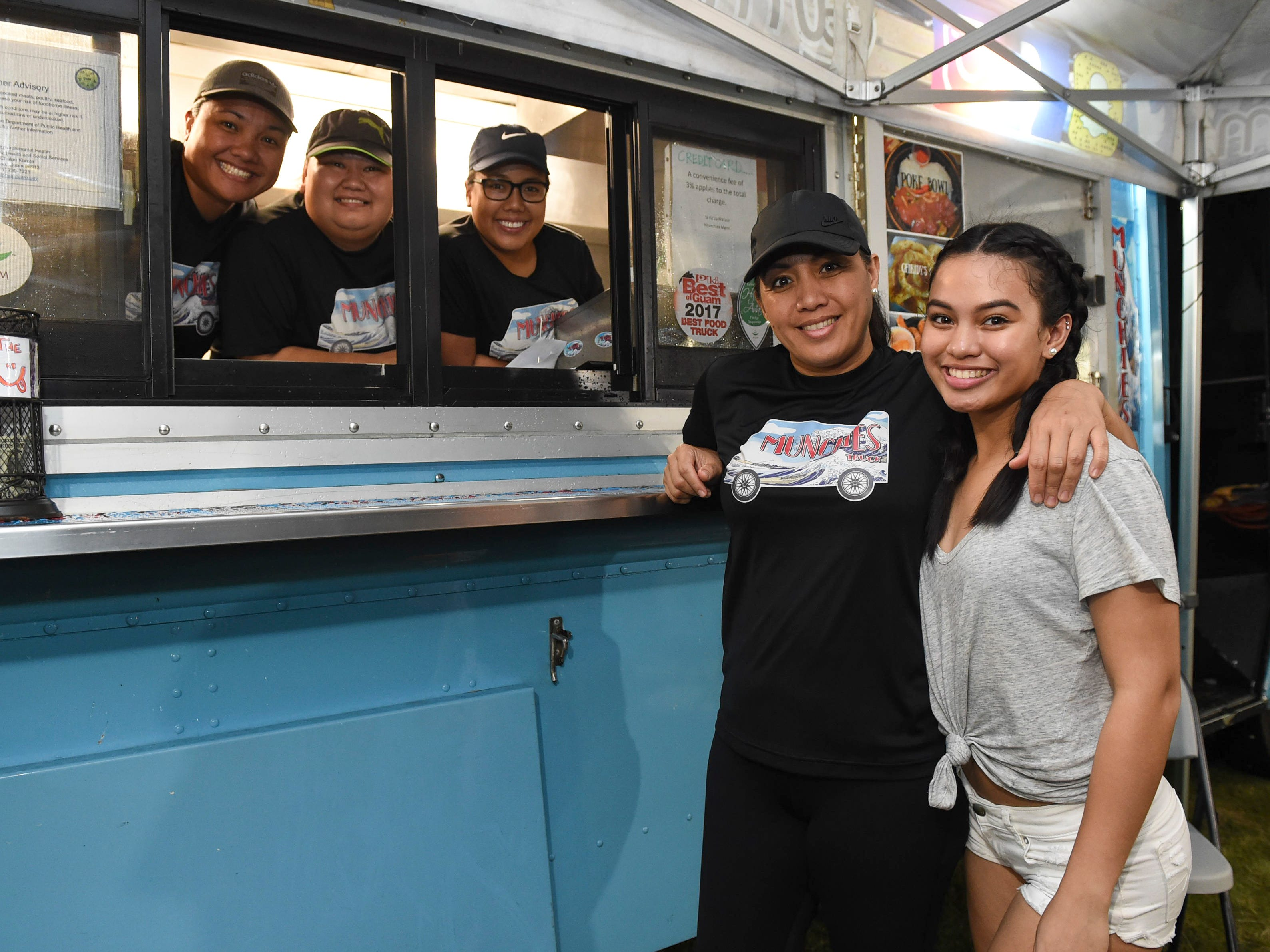 Munchies Food Truck Guam employees take a quick photo break during New Year's Eve at the Gov. Joseph Flores Beach Park on Dec. 31, 2018.