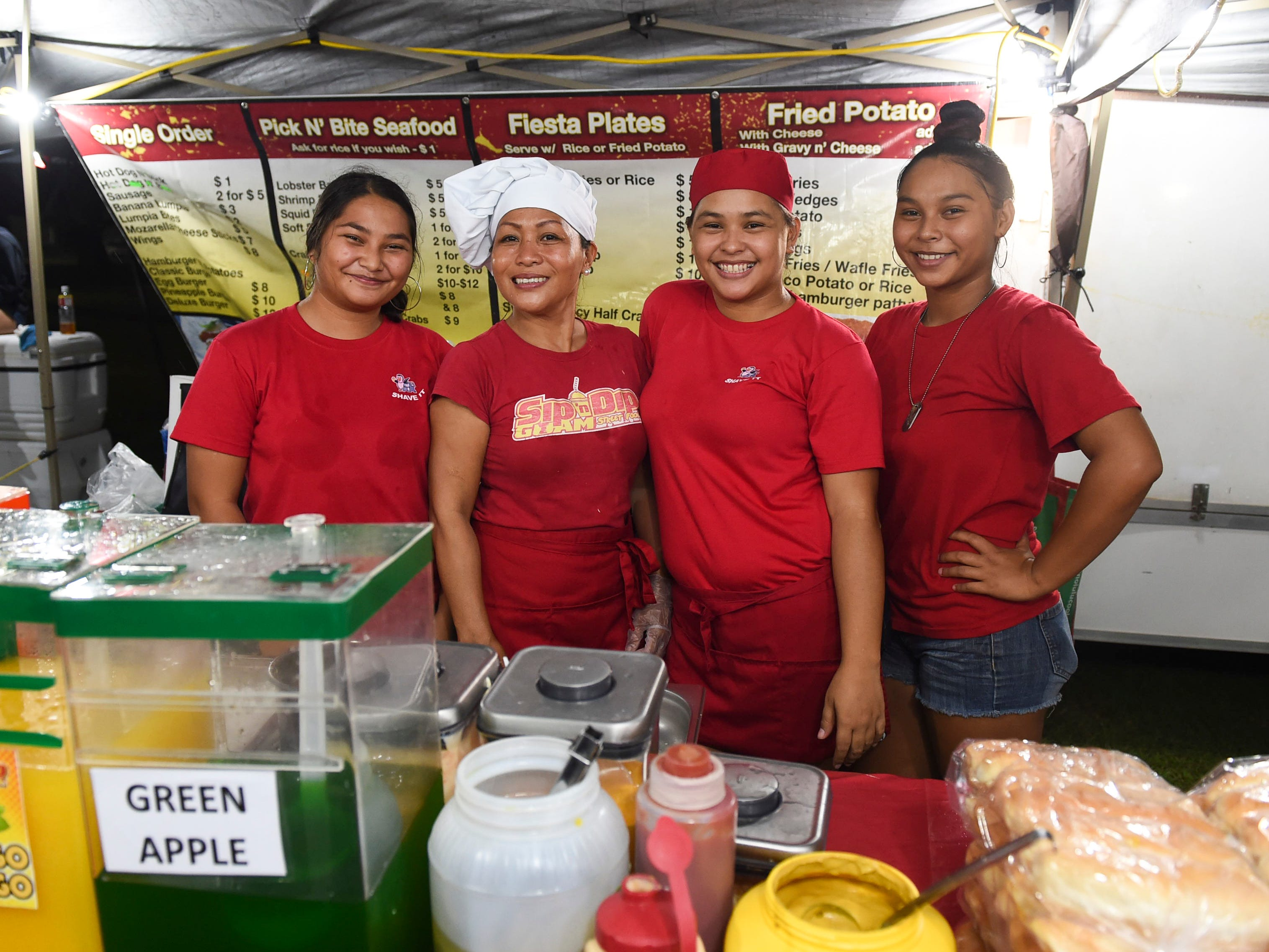 Sip N' Dip Guam and Shave It employees during New Year's Eve at the Gov. Joseph Flores Beach Park on Dec. 31, 2018. From left: Tisha Indalecio, owner Marisol Malumay, Leila Evaristo, and Liela Evaristo.