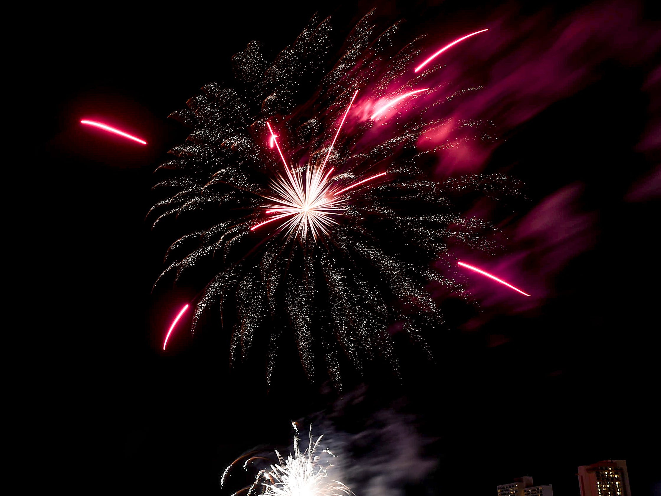 New Year's Day fireworks designs explode over Tumon Bay, Jan. 1, 2019.