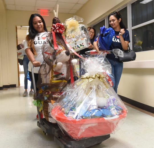 "Archway, Inc. members roll in baskets of gifts for the New Year's Day baby as part of the ""I Love Guam New Year Baby"" program at Guam Memorial Hospital in Tamuning on Jan. 1, 2019."