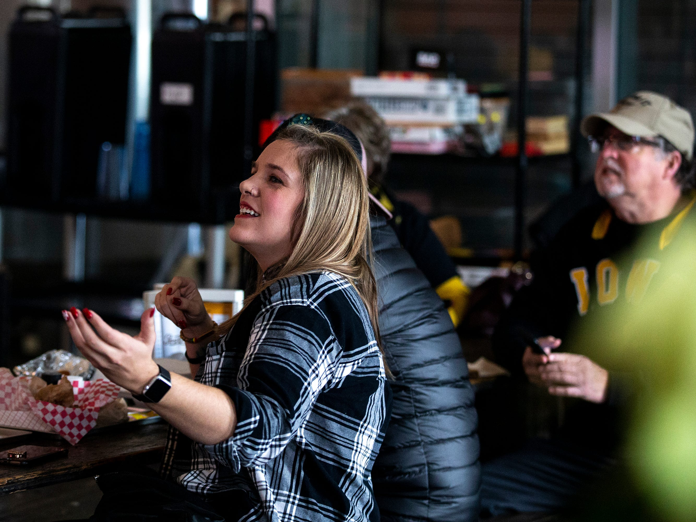 Kelsey Jenn, of Urbandale, watches the University of Iowa football team play in the Outback Bowl on Tuesday, Jan. 1, 2019, at The Hall in West Des Moines.