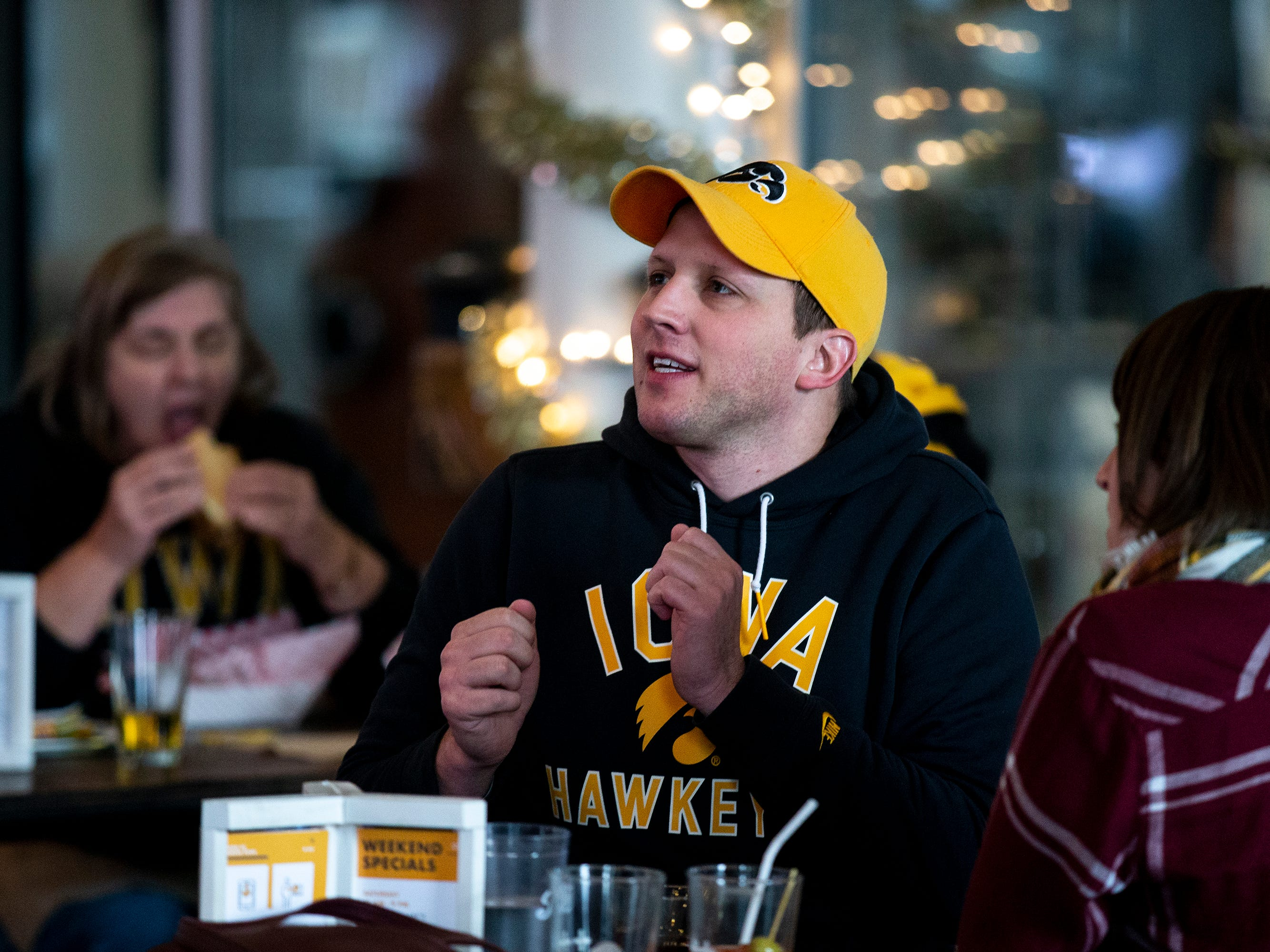 Nick Young, of Des Moines, watches the University of Iowa football team play in the Outback Bowl on Tuesday, Jan. 1, 2019, at The Hall in West Des Moines.
