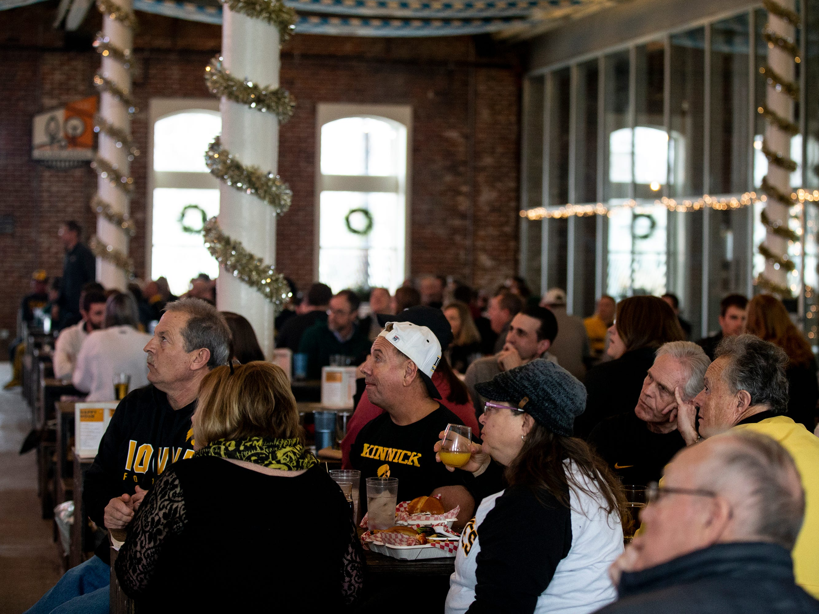 Hawkeye fans watch the University of Iowa football team play in the Outback Bowl on Tuesday, Jan. 1, 2019, at The Hall in West Des Moines.