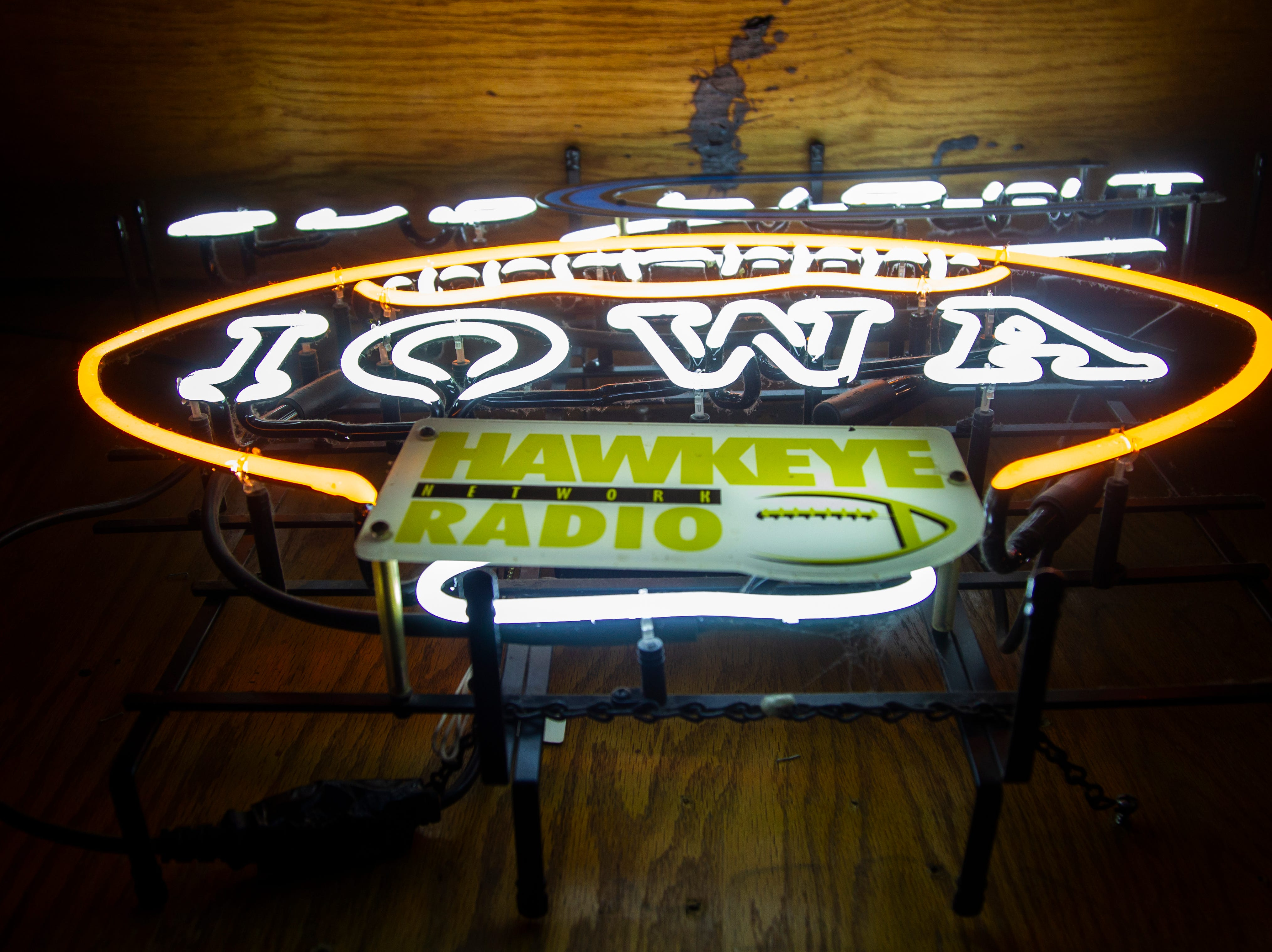 A neon Bud Light sign with a Hawkeye Radio Network logo and Iowa football hangs on a wall on Tuesday, Jan. 1, 2019, at Sports Column on S. Dubuque Street in Iowa City.