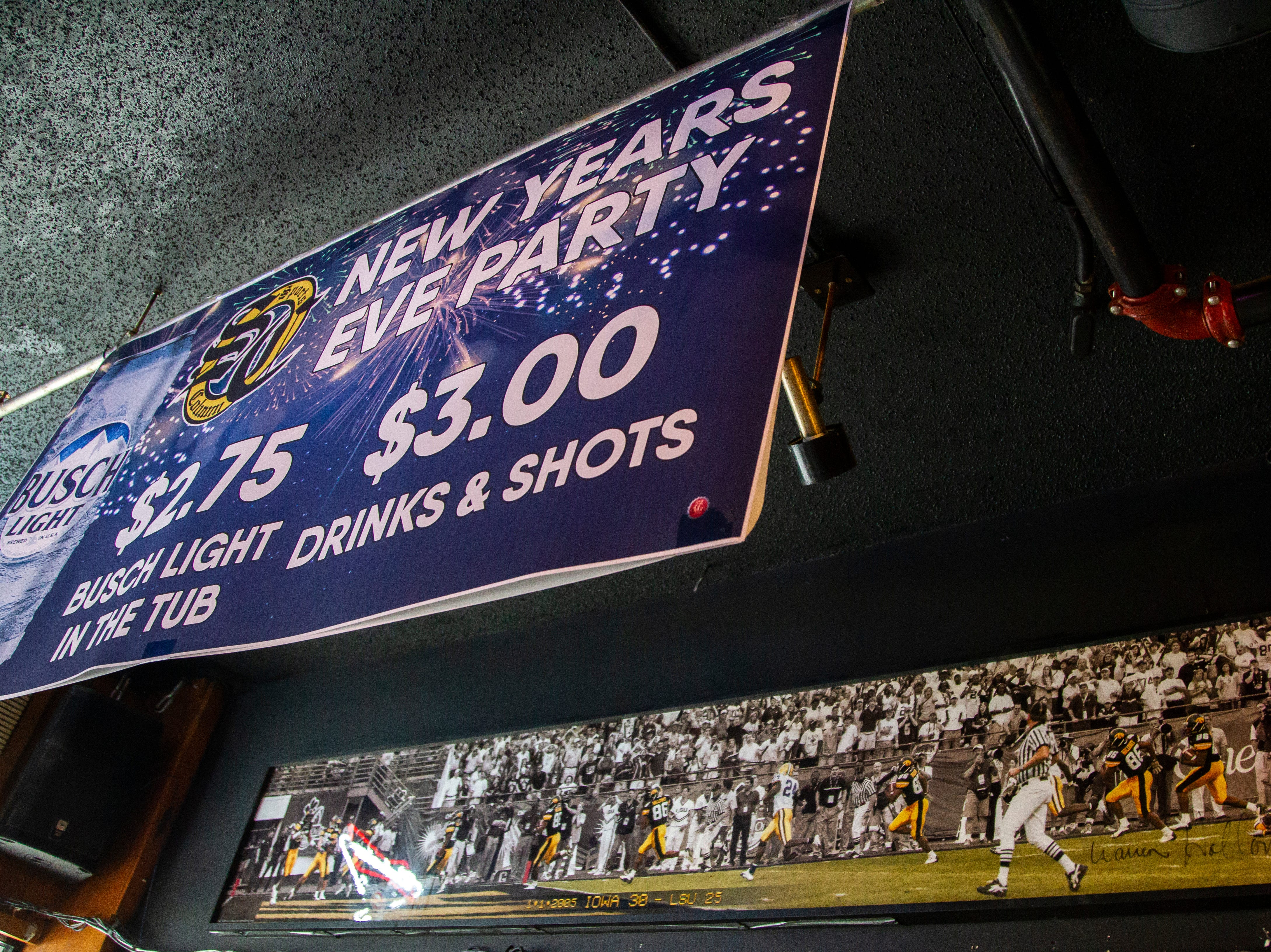 A signed panoramic photo of Warren Holloway's 2005 Capitol One Bowl last minute 56-yard touchdown on Tuesday, Jan. 1, 2019, at Sports Column on S. Dubuque Street in Iowa City.