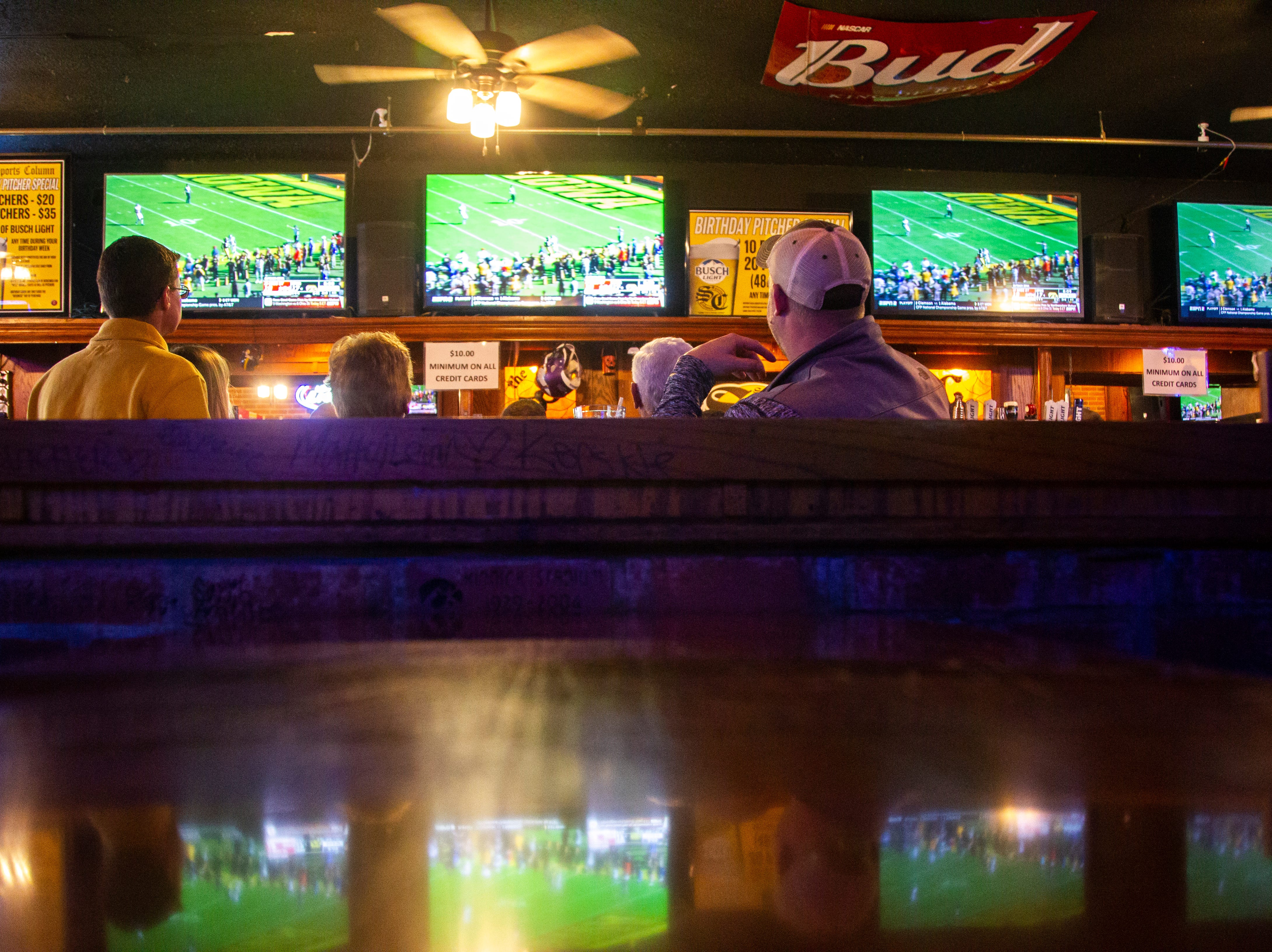 Iowa fans watch the Iowa vs. Mississippi State Outback Bowl football game on Tuesday, Jan. 1, 2019, at Sports Column on S. Dubuque Street in Iowa City.