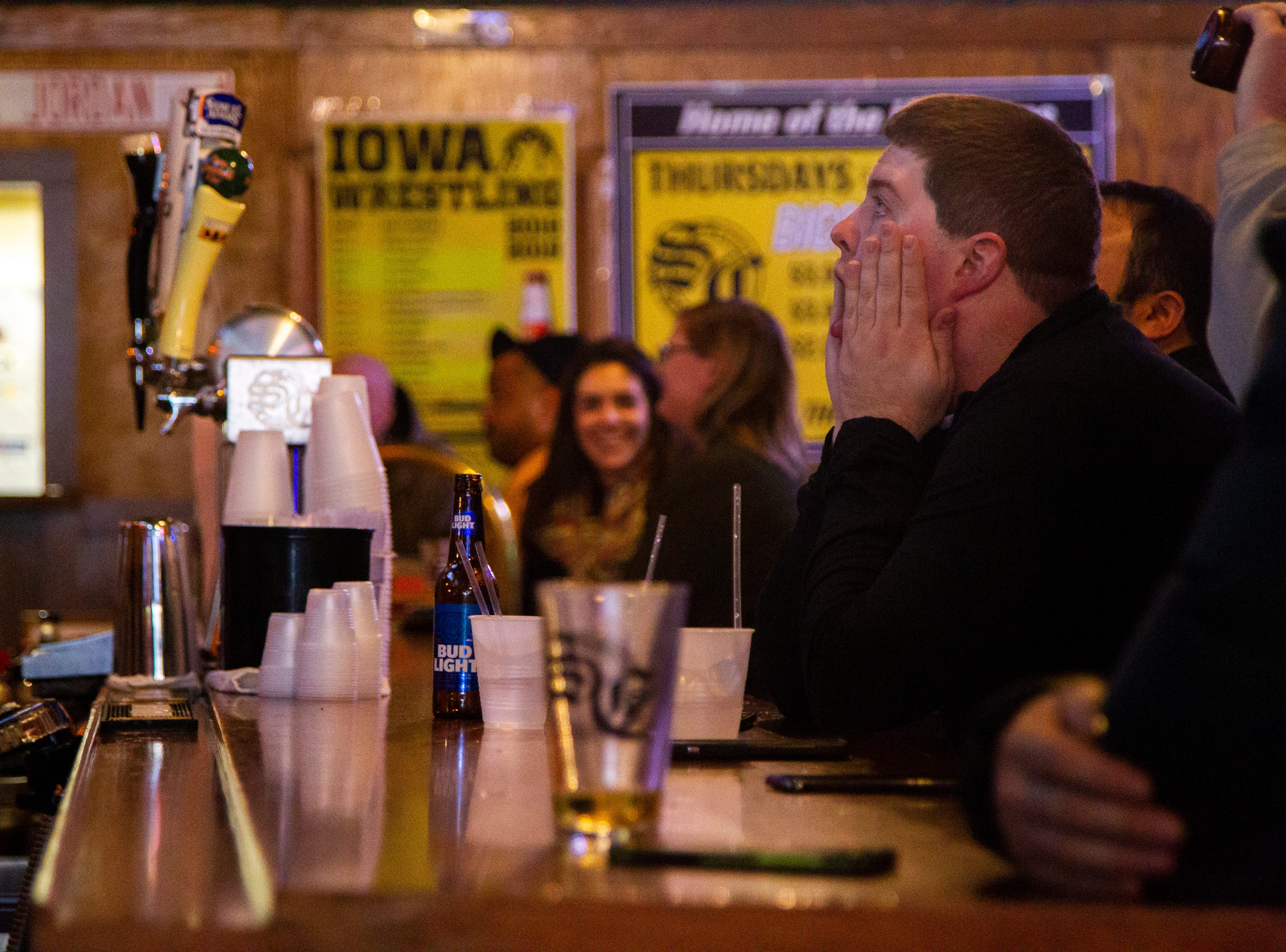 Iowa fans watch intently during the finals drive while watching the Iowa vs. Mississippi State Outback Bowl football game on Tuesday, Jan. 1, 2019, at Sports Column on S. Dubuque Street in Iowa City.