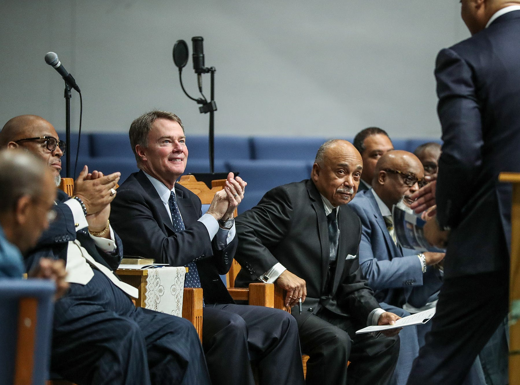 Mayor Joe Hogsett and clergymen look on after U.S. Rep. Andre Carson delivered remarks on the state of the nation during a service celebrating the anniversary of the Emancipation Proclamation and honoring local leaders, at Olivet Missionary Baptist Church in Indianapolis, Tuesday, Jan. 1, 2019.