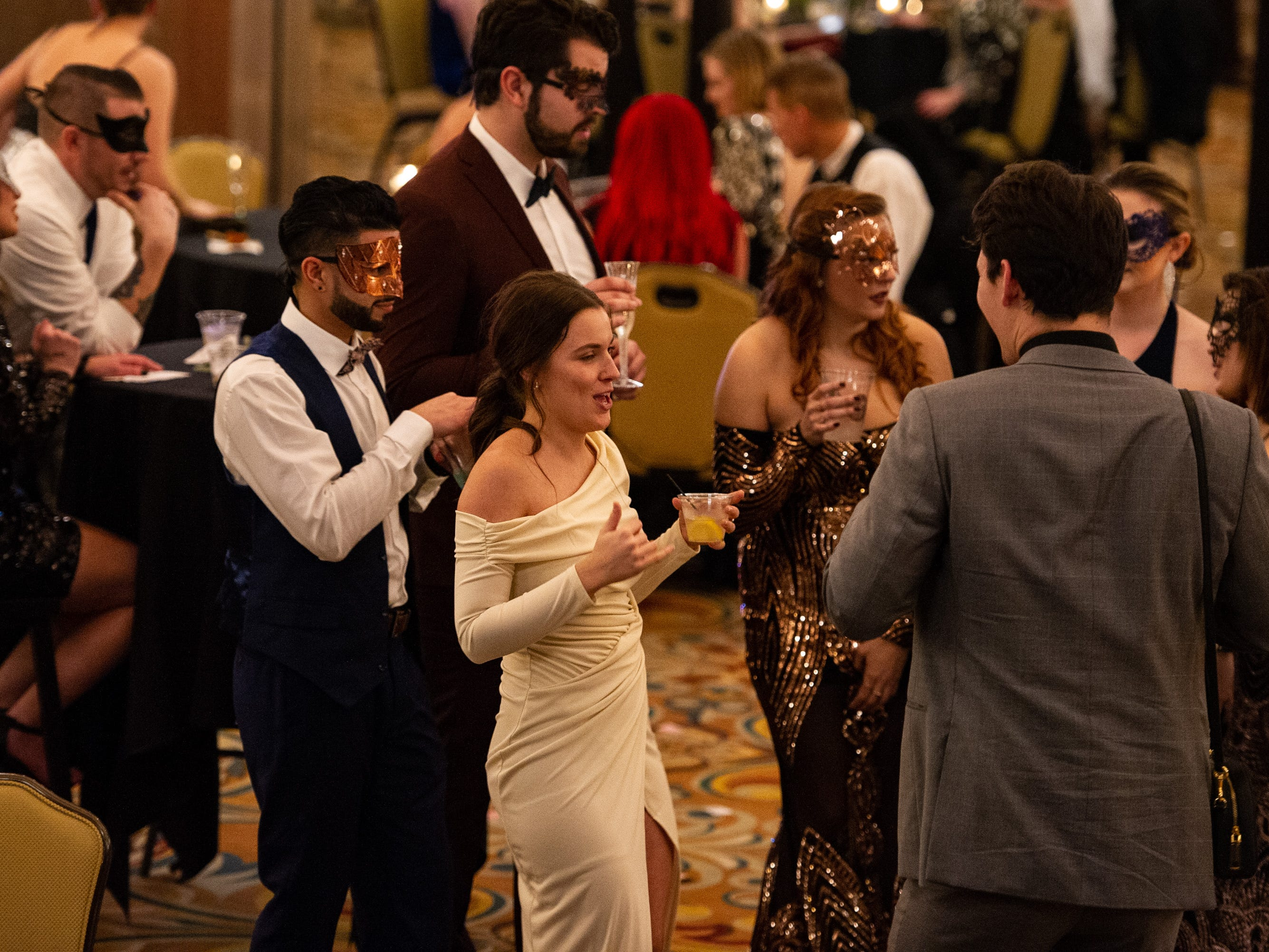 Guests mingle during the event Monday, Dec. 31, 2018, at The 12th Annual Indy Masquerade held at Union Station in Indianapolis.
