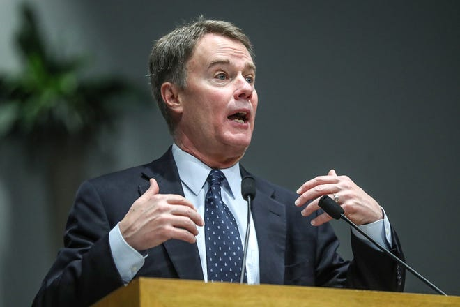 Mayor Joe Hogsett delivers remarks on the state of the city during a service celebrating the anniversary of the Emancipation Proclamation and honoring local leaders, at Olivet Missionary Baptist Church in Indianapolis, Tuesday, Jan. 1, 2019.