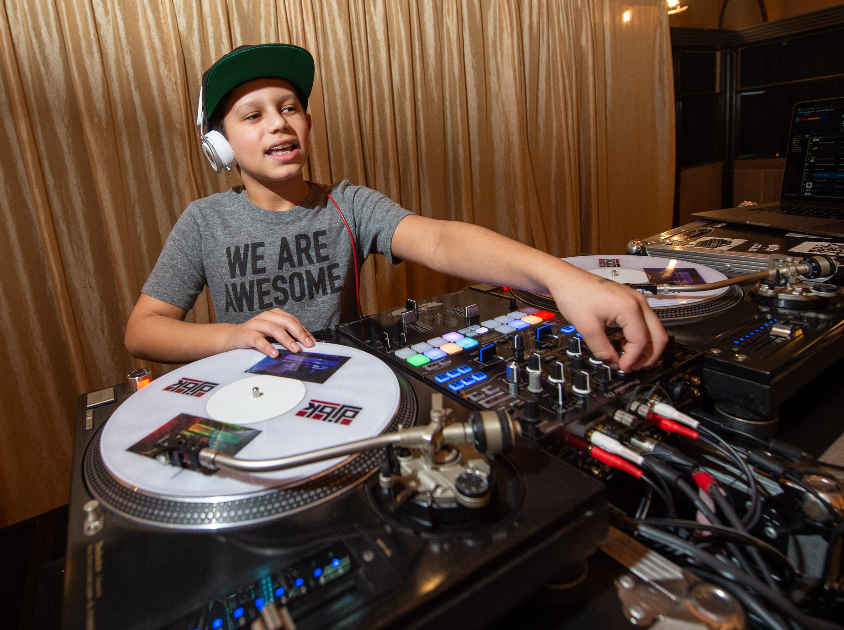 Eleven Year old DJ BK entertains the guests Monday, Dec. 31, 2018, at The 12th Annual Indy Masquerade held at Union Station in Indianapolis.