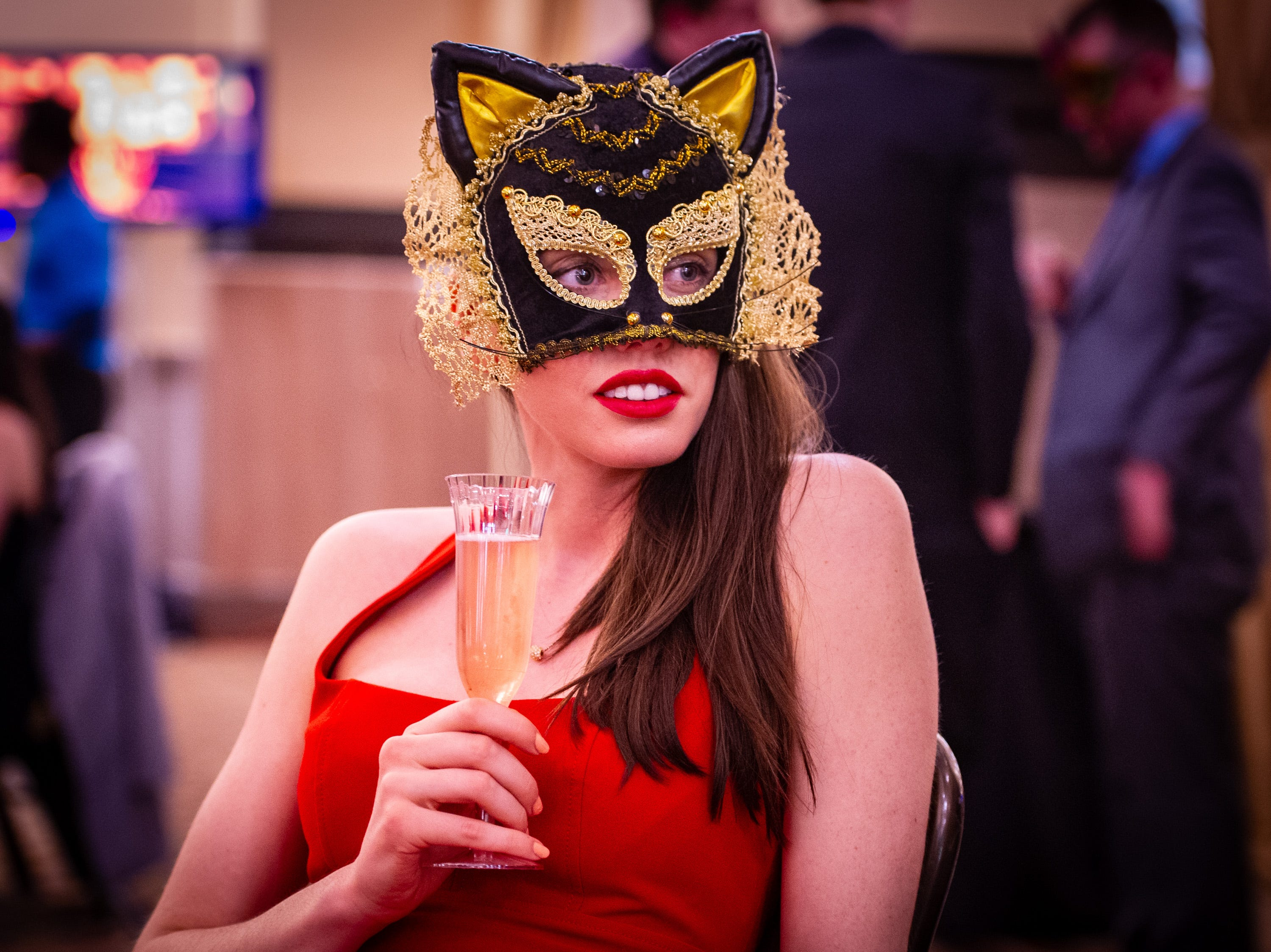 Molly Meiners, of Indianapolis, soaks up the atmosphere during the event Monday, Dec. 31, 2018, at The 12th Annual Indy Masquerade held at Union Station in Indianapolis.
