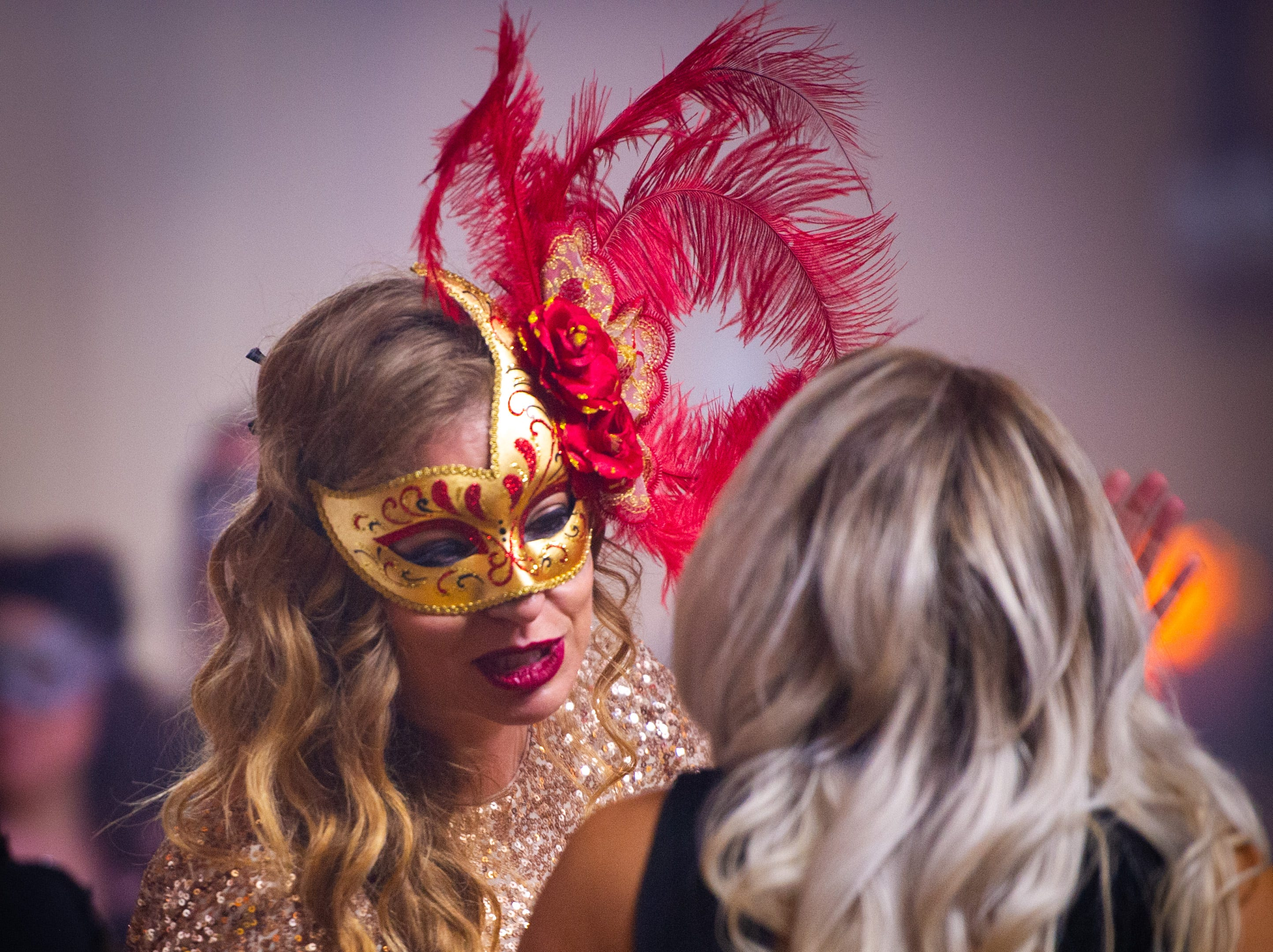Costumed guests mingle Monday, Dec. 31, 2018, at The 12th Annual Indy Masquerade held at Union Station in Indianapolis.