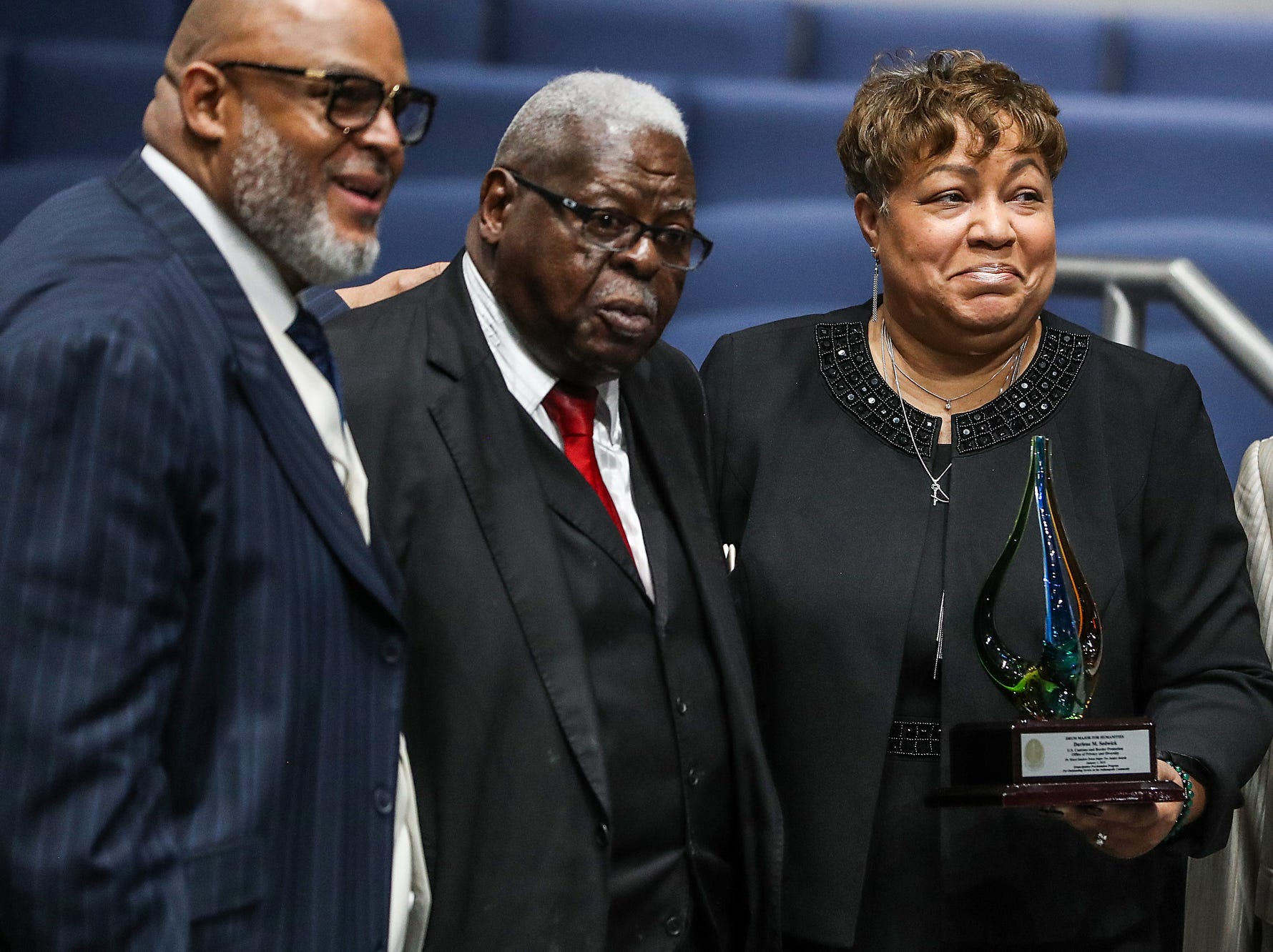 From left, Rev. Dr. Wayne Moore, Rev. Dr. Fitzhugh Lyons and Darlene Sedwick pose for a photo after Sedwick received the Drum Major for Humanities Award, during a service celebrating the anniversary of the Emancipation Proclamation at Olivet Missionary Baptist Church in Indianapolis, Tuesday, Jan. 1, 2019. Sedwick is director of the Office of Privacy and Diversity at U.S. Customs and Border Protection in Indianapolis.