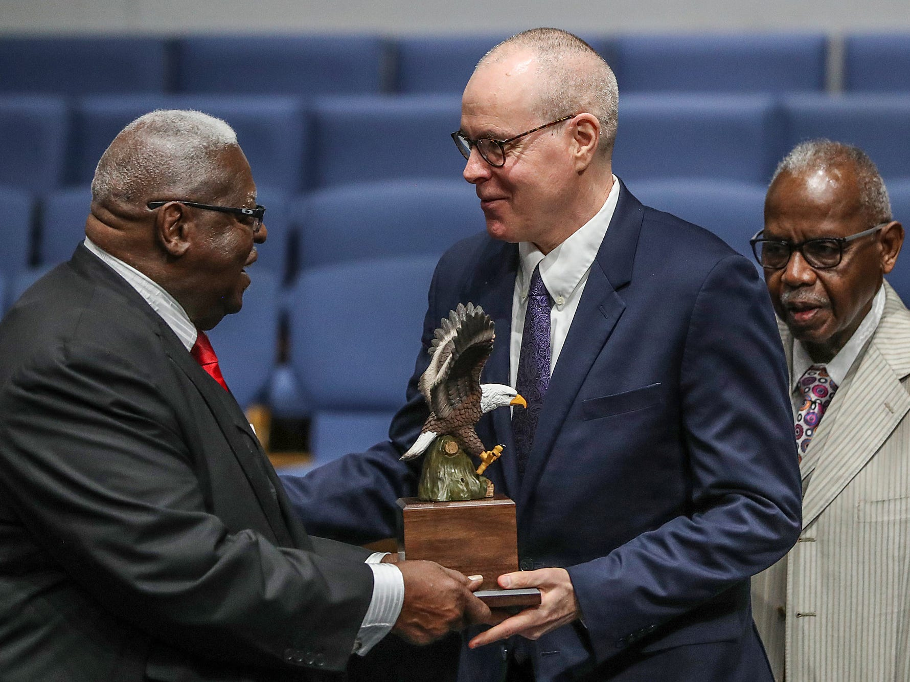 Rev. Dr. Fitzhugh Lyons hands the Faith Based President's Award to Fran Quigley, during a service celebrating the anniversary of the Emancipation Proclamation at Olivet Missionary Baptist Church in Indianapolis, Tuesday, Jan. 1, 2019. Quigley is a law professor at Indiana University's McKinney School of Law.