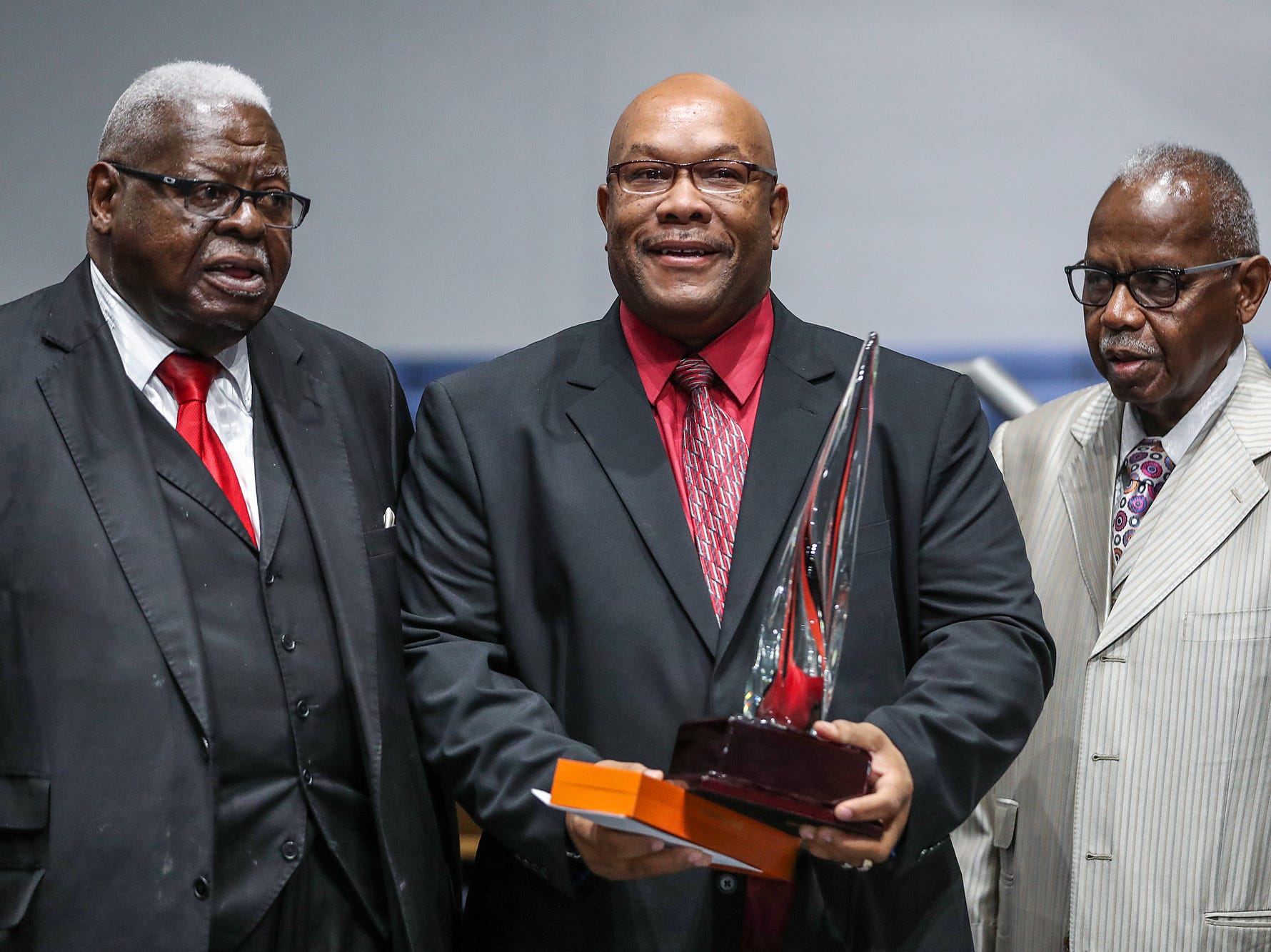 Rev. Dr. Fitzhugh Lyons, Rev. Darryl Taylor and Rev. Dr. Melvin Girton pose for a photo, after Taylor received the Dr. Andrew J. Brown Clergy Person of the Year Award, during a service celebrating the anniversary of the Emancipation Proclamation at Olivet Missionary Baptist Church in Indianapolis, Tuesday, Jan. 1, 2019. Taylor is Pastor of Paraclete Life at Arlington Heights Baptist Church.