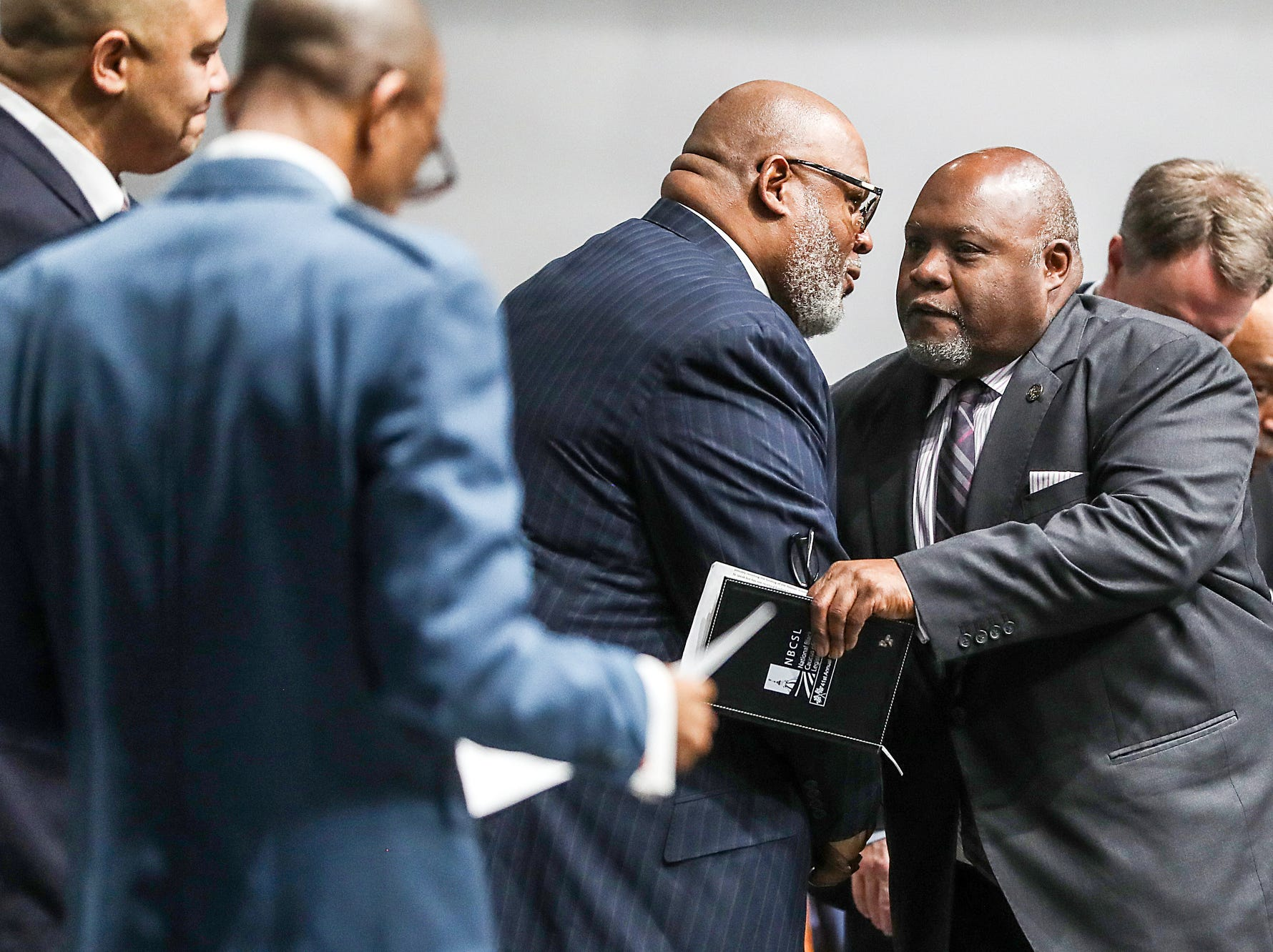 State Rep. Greg Porter greets clergymen before delivering remarks on the state of the state during a service celebrating the anniversary of the Emancipation Proclamation and honoring local leaders, at Olivet Missionary Baptist Church in Indianapolis, Tuesday, Jan. 1, 2019.