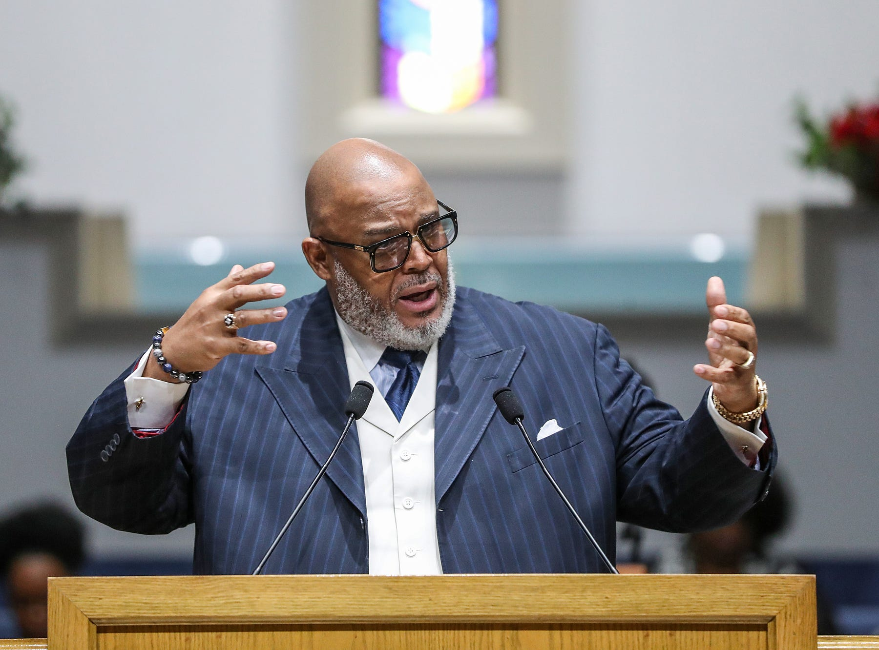 Rev. Dr. Wayne Moore delivers a sermon during a service celebrating the anniversary of the Emancipation Proclamation and honoring local leaders, at Olivet Missionary Baptist Church in Indianapolis, Tuesday, Jan. 1, 2019.