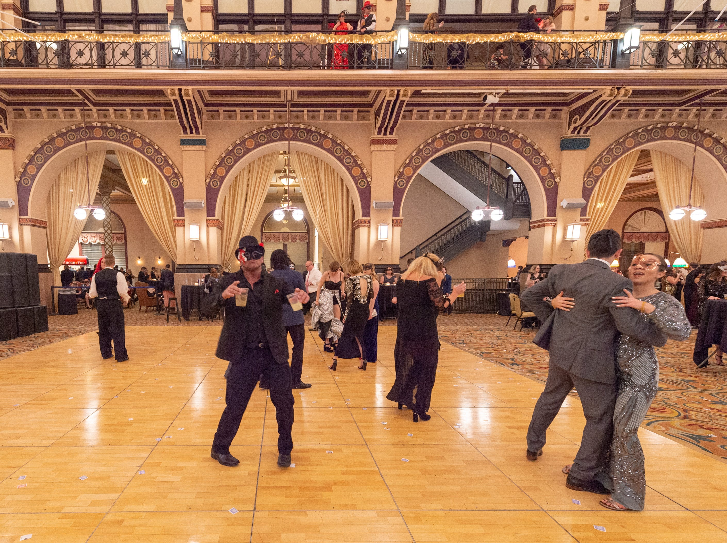 Guests enjoy the dance floor Monday, Dec. 31, 2018, at The 12th Annual Indy Masquerade held at Union Station in Indianapolis.