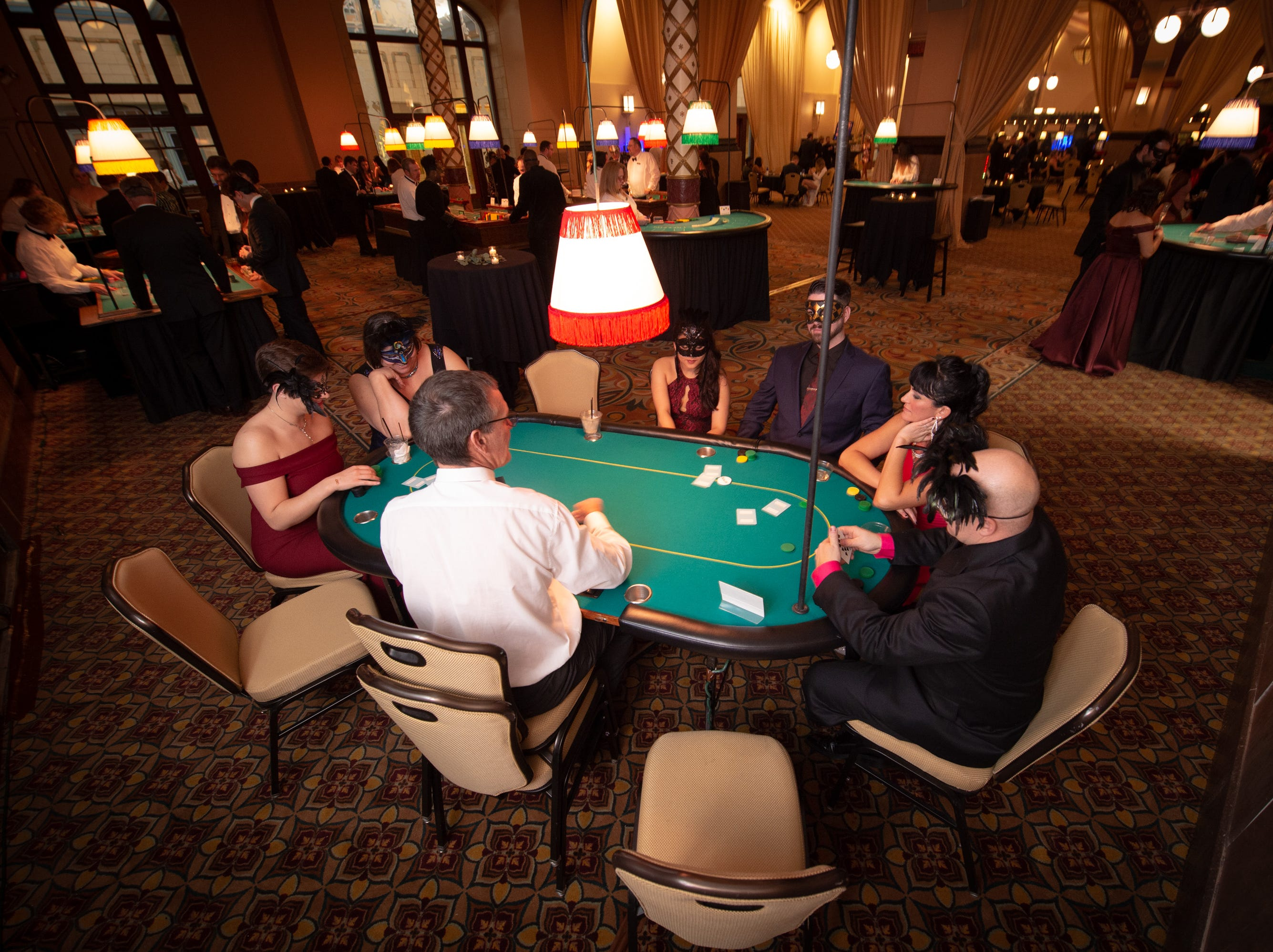 A casino atmosphere helped set the scene for guests Monday, Dec. 31, 2018, at The 12th Annual Indy Masquerade held at Union Station in Indianapolis.