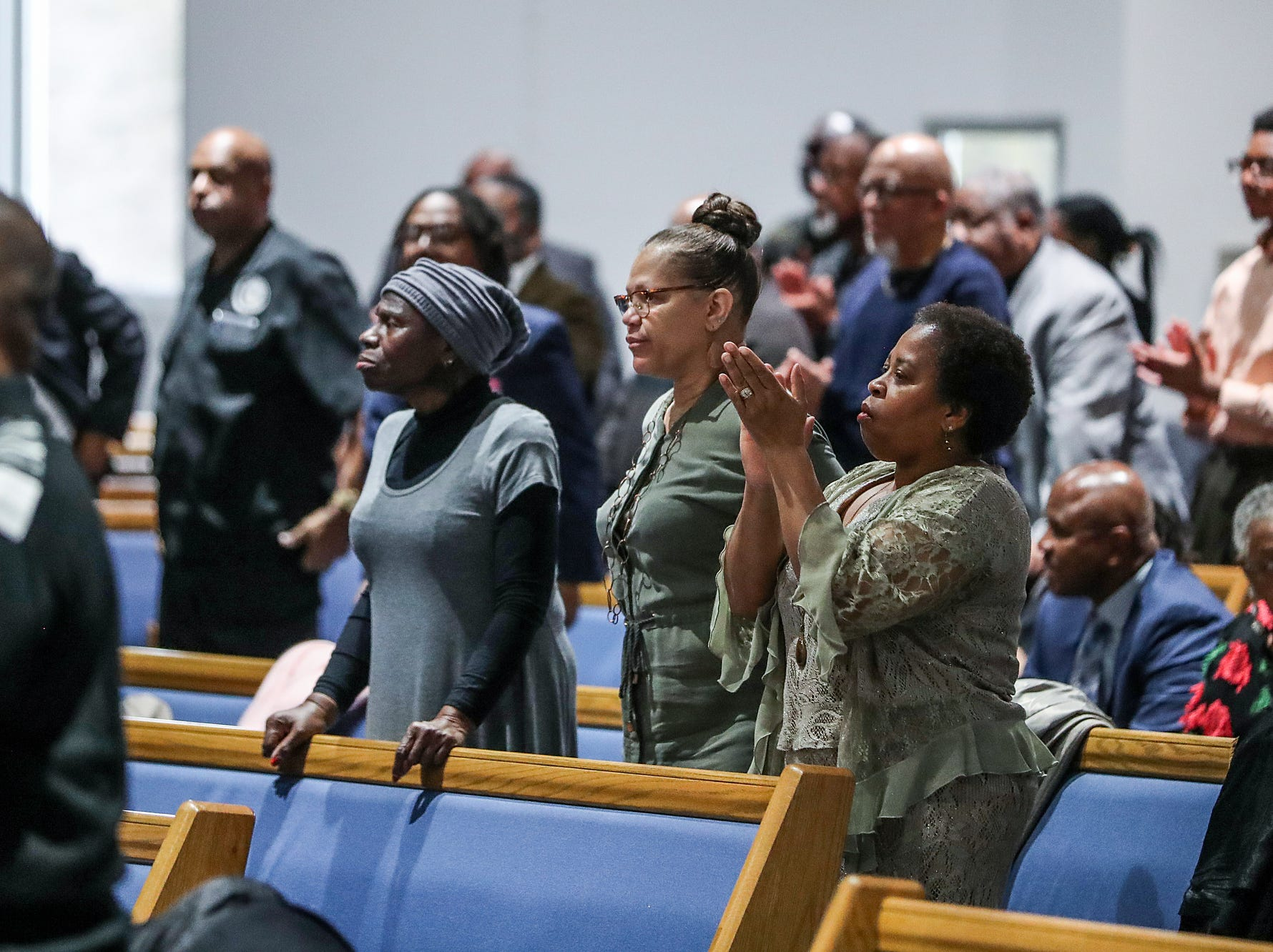 Spectators listen on during a service celebrating the anniversary of the Emancipation Proclamation and honoring local leaders, at Olivet Missionary Baptist Church in Indianapolis, Tuesday, Jan. 1, 2019.