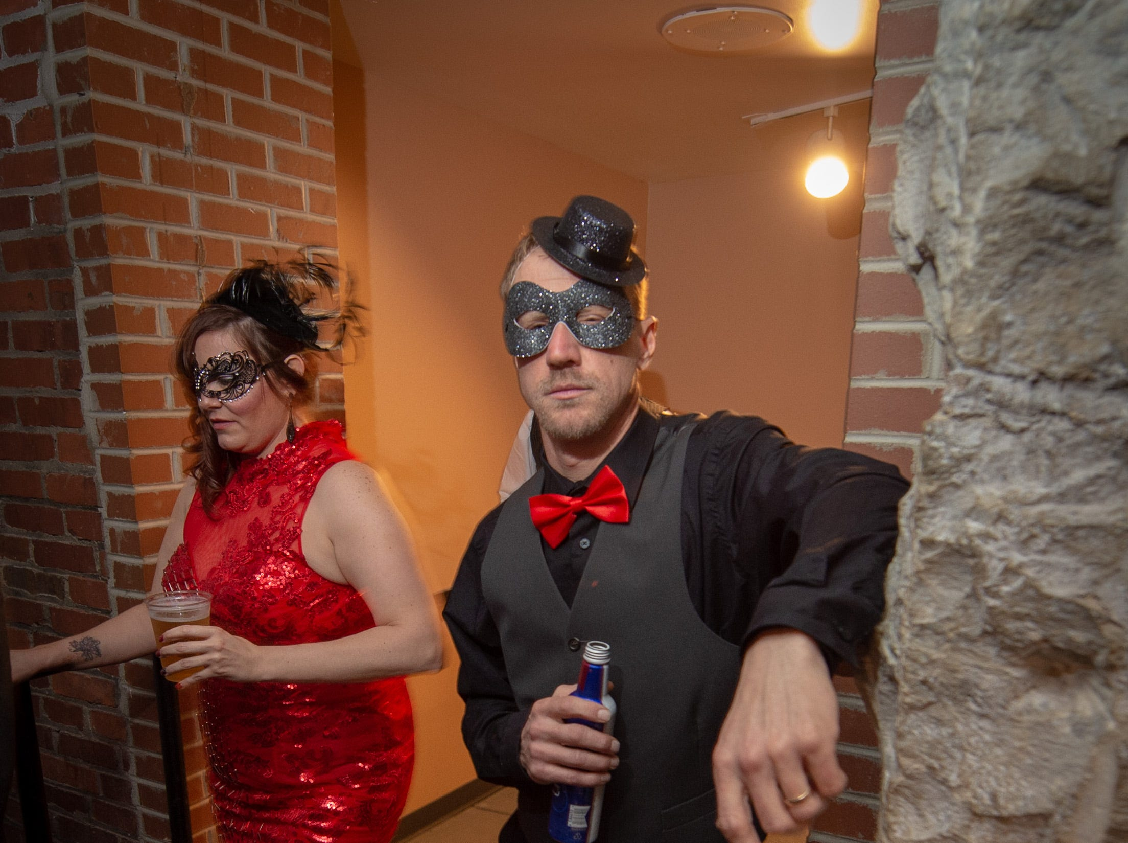 Guests mingle Monday, Dec. 31, 2018, at The 12th Annual Indy Masquerade held at Union Station in Indianapolis.