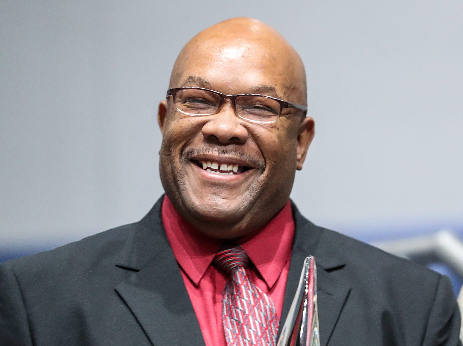 Rev. Darryl Taylor smiles after he received the Dr. Andrew J. Brown Clergy Person of the Year Award during a service celebrating the anniversary of the Emancipation Proclamation at Olivet Missionary Baptist Church in Indianapolis, Tuesday, Jan. 1, 2019. Taylor is Pastor of Paraclete Life at Arlington Heights Baptist Church.