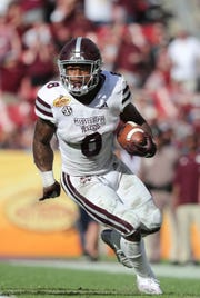 Jan 1, 2019; Tampa, FL, USA; Mississippi State Bulldogs running back Kylin Hill (8) runs with the ball against the Iowa Hawkeyes during the second half in the 2019 Outback Bowl at Raymond James Stadium. Mandatory Credit: Kim Klement-USA TODAY Sports