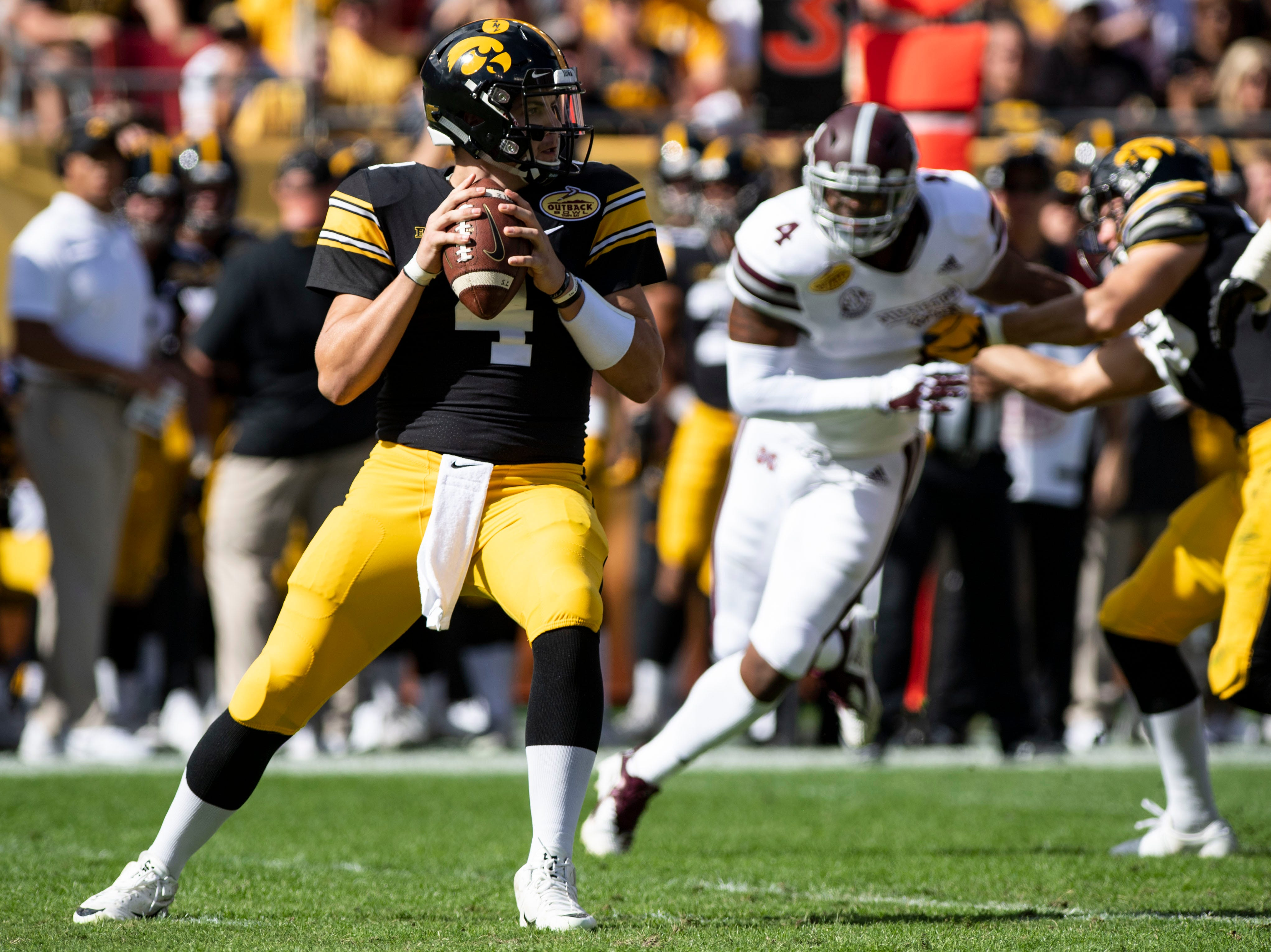 Jan 1, 2019; Tampa, FL, USA; Iowa Hawkeyes quarterback Nate Stanley (4) looks to pass during the first quarter against the Mississippi State Bulldogs in the 2019 Outback Bowl at Raymond James Stadium. Mandatory Credit: Douglas DeFelice-USA TODAY Sports