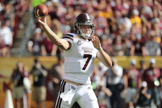 Jan 1, 2019; Tampa, FL, USA; Mississippi State Bulldogs quarterback Nick Fitzgerald (7) throws the ball against the Iowa Hawkeyes during the first quarter in the 2019 Outback Bowl at Raymond James Stadium. Mandatory Credit: Kim Klement-USA TODAY Sports