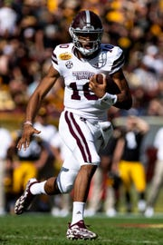 Jan 1, 2019; Tampa, FL, USA; Mississippi State Bulldogs quarterback Keytaon Thompson (10) runs the ball during the first quarter against the Iowa Hawkeyes in the 2019 Outback Bowl at Raymond James Stadium. Mandatory Credit: Douglas DeFelice-USA TODAY Sports
