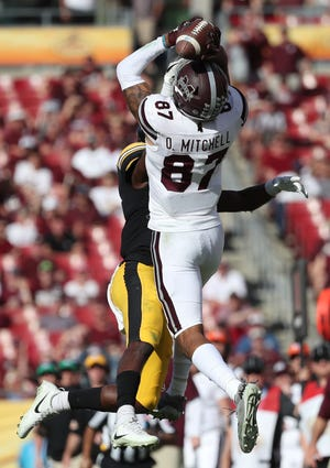 Jan 1, 2019; Tampa, FL, USA; Mississippi State Bulldogs wide receiver Osirus Mitchell (87) catches the ball over Iowa Hawkeyes defensive back Michael Ojemudia (11) during the second half in the 2019 Outback Bowl at Raymond James Stadium. Mandatory Credit: Kim Klement-USA TODAY Sports