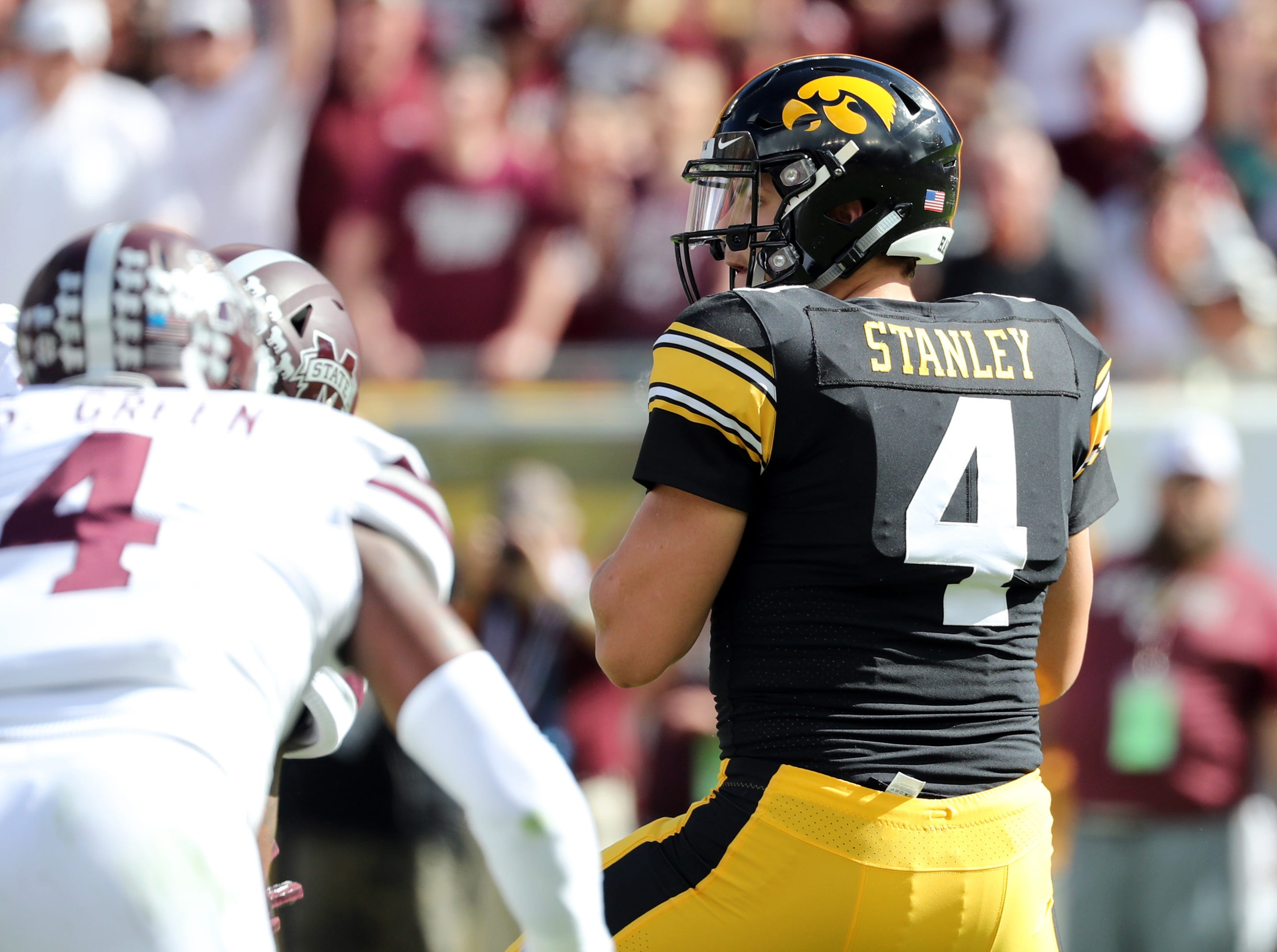 Jan 1, 2019; Tampa, FL, USA; Iowa Hawkeyes quarterback Nate Stanley (4) throws the ball against the Mississippi State Bulldogs during the first quarter in the 2019 Outback Bowl at Raymond James Stadium. Mandatory Credit: Kim Klement-USA TODAY Sports