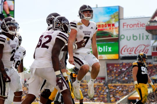 Jan 1, 2019; Tampa, FL, USA; Mississippi State Bulldogs quarterback Nick Fitzgerald (7) celebrates after scoring a touchdown against the Iowa Hawkeyes during the second half in the 2019 Outback Bowl at Raymond James Stadium. Mandatory Credit: Kim Klement-USA TODAY Sports