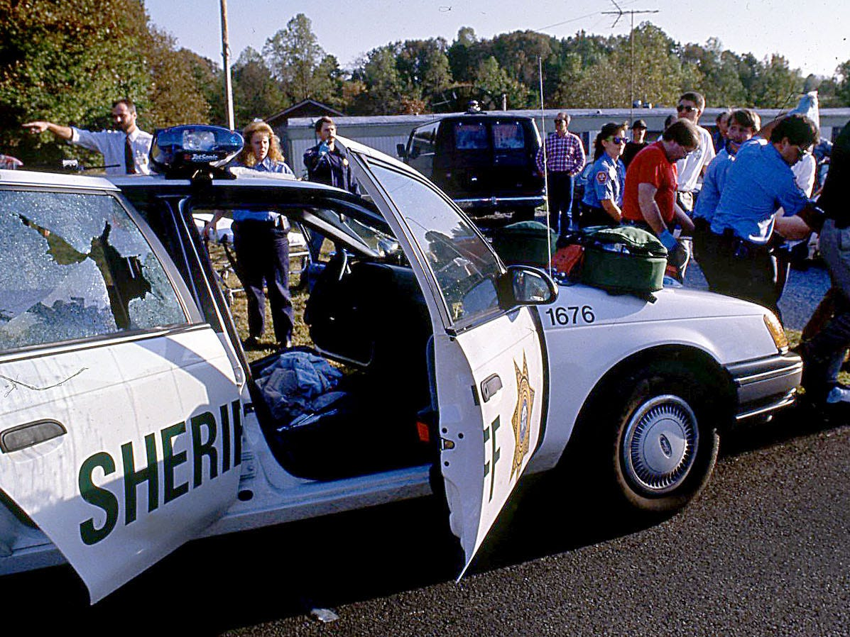 Medical workers take Sheriff's Deputy James Carson from his bullet-riddled car to a MedFlight helicopter Oct. 16, 1991. Carson and his partner Matt Baird were ambushed while on a call in deep West Knox County.