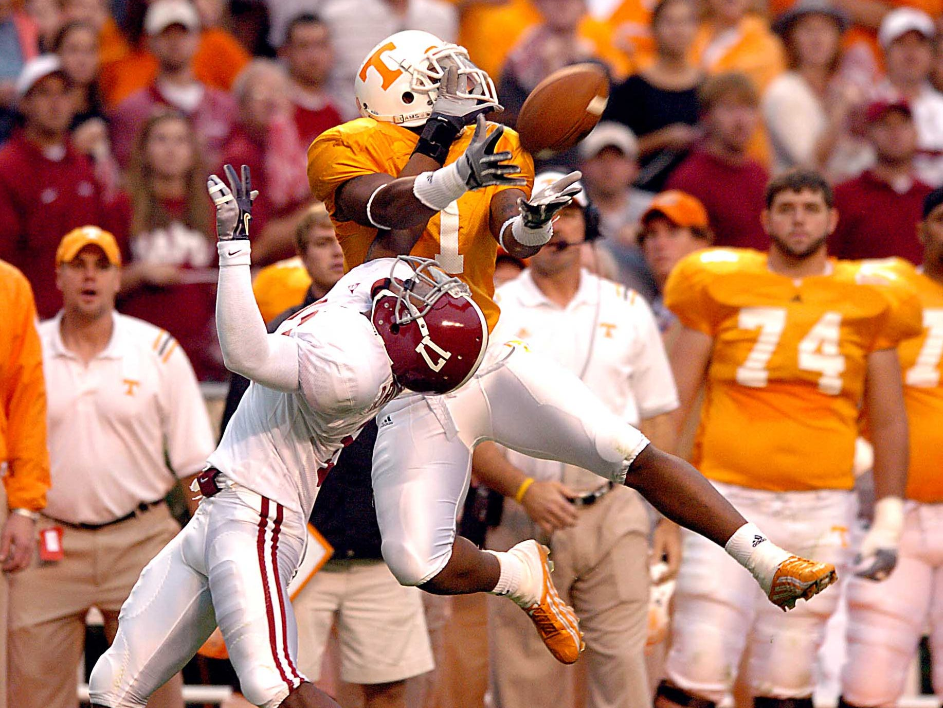 Tennessee wide receiver Jayson Swain catches a pass over Alabama cornerback Ramzee Robinson during the third quarter Saturday at Neyland Stadium Oct. 23, 2004.